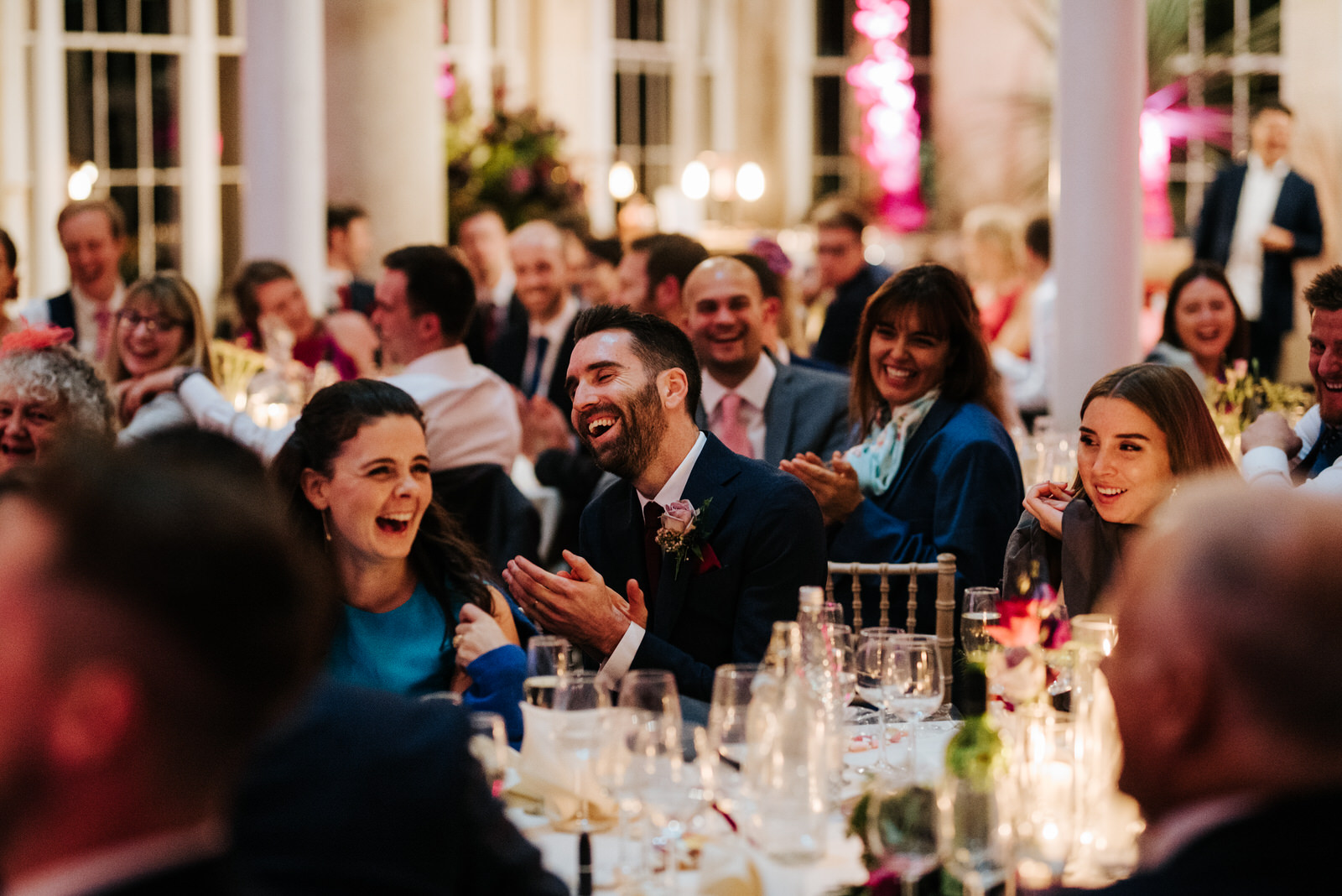 Groom's brother and sister can't contain laughter during his wedding speech