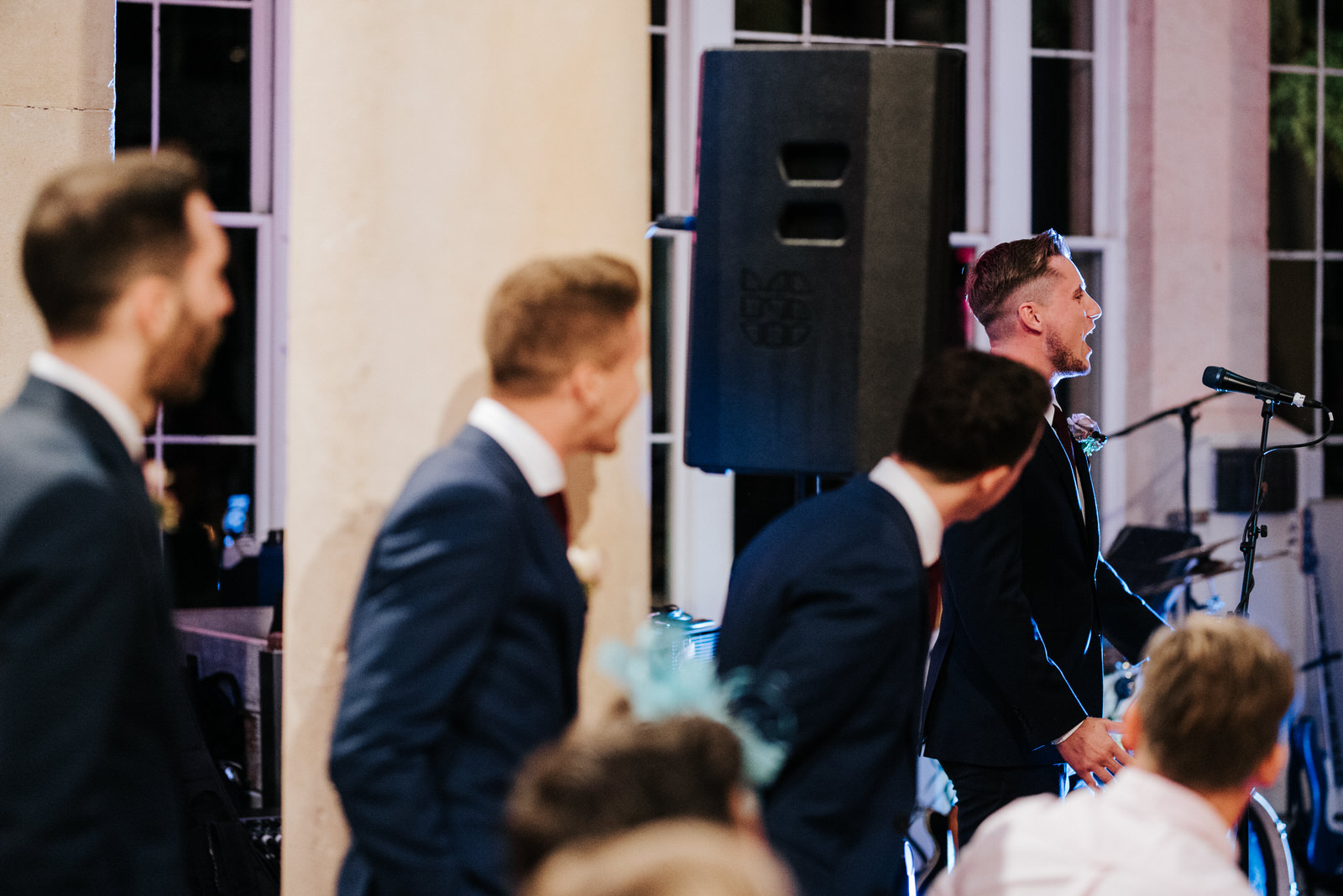 Groomsmen take turns delivering their wedding speeches