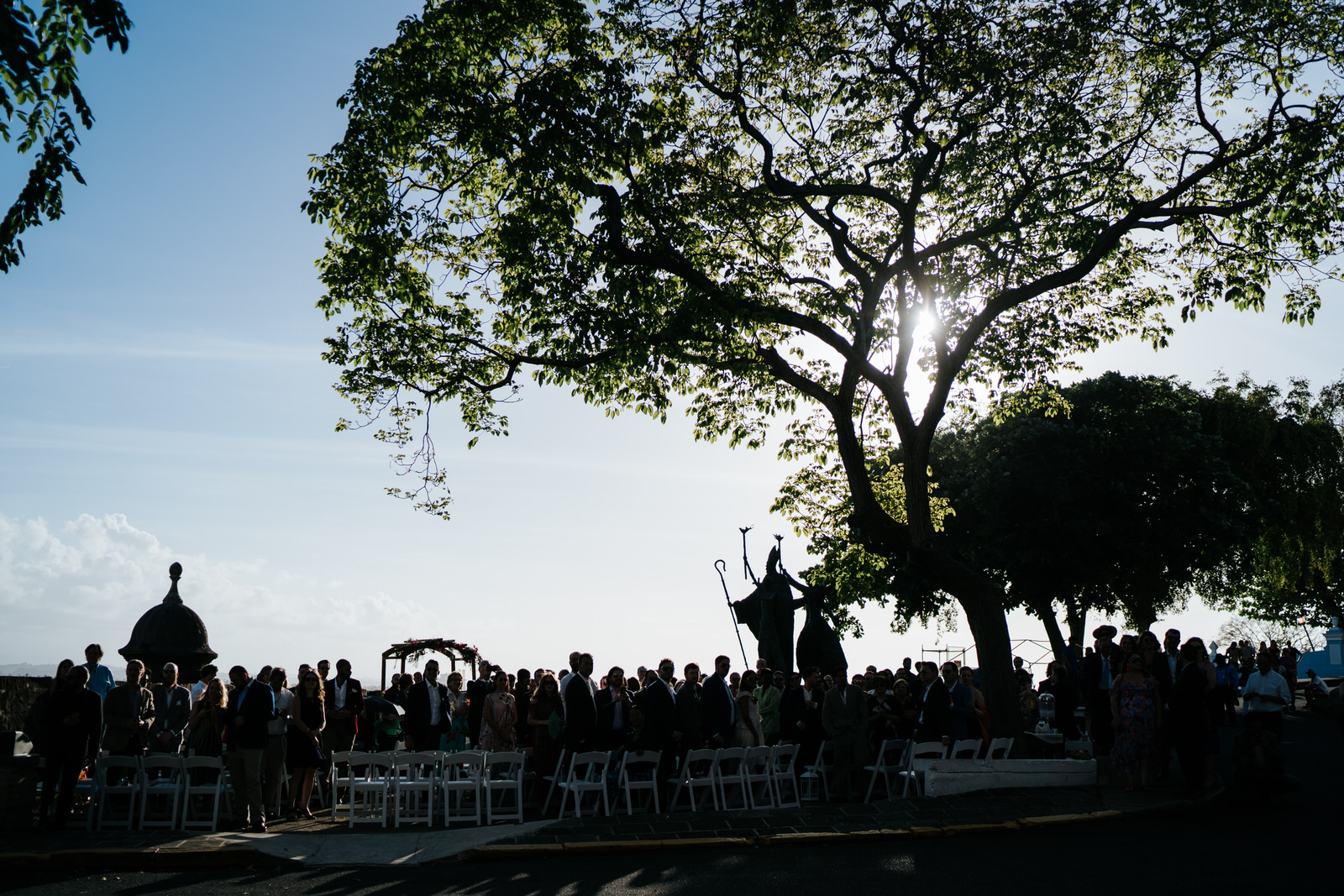 Silhouetter shot of all the guests waiting in the streets of Old San Juan Puerto Rico for the wedding to begin