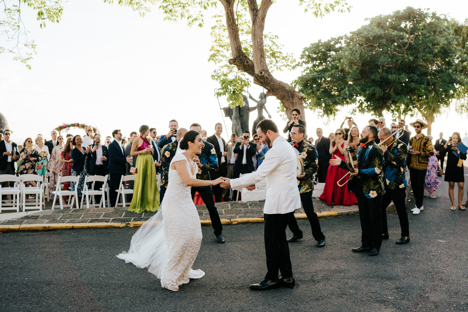 Bride and groom have walked back down the aisle and are seen dancing on the streets of Old San Juan after their wedding ceremony