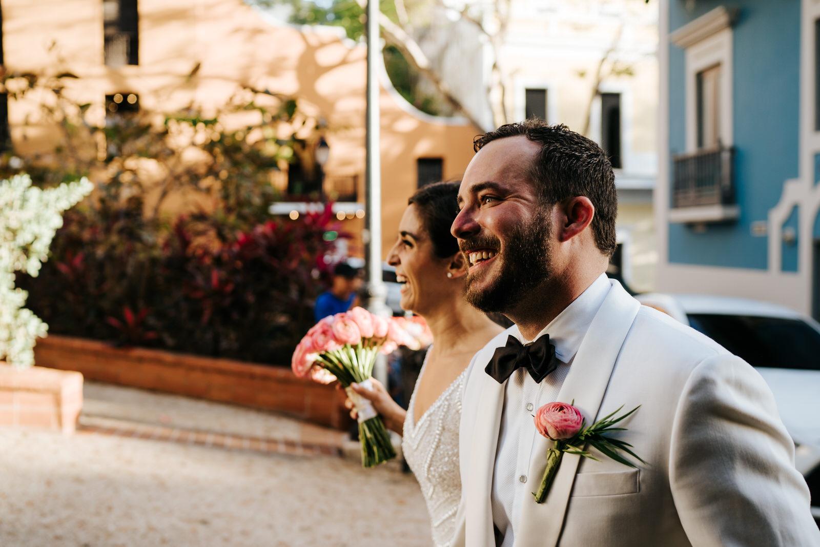 Bride and groom arrive at El Convento Hotel Wedding Venue and smile