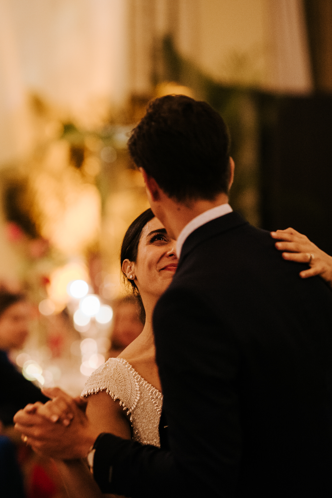 Bride dances with family member as she looks at him very happily