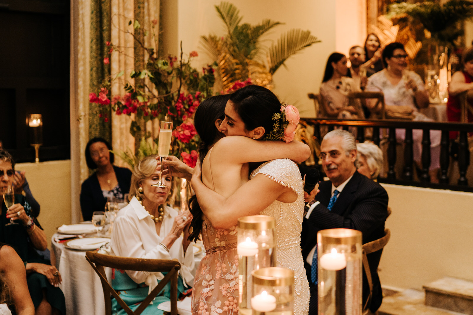 Bride hugs her best friend after she finishes her wedding speech