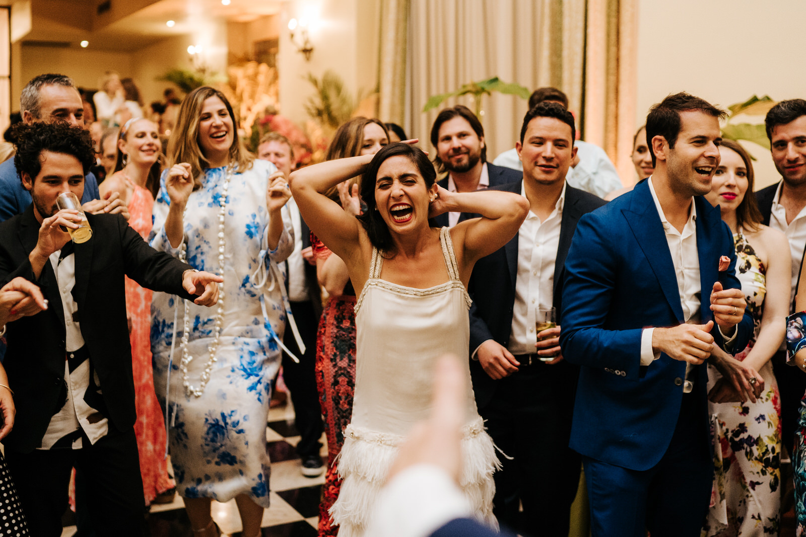 Bride is laughing in hysterics on the dancefloor