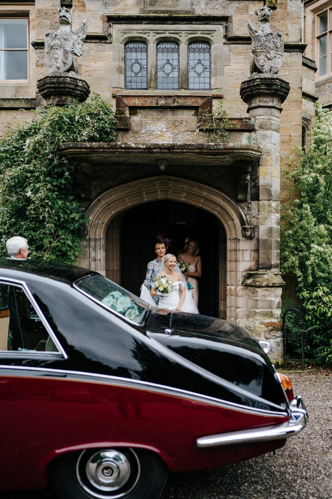 Bride, bridesmaids and mother of the bride exit Hawarden Castle Wedding Venue