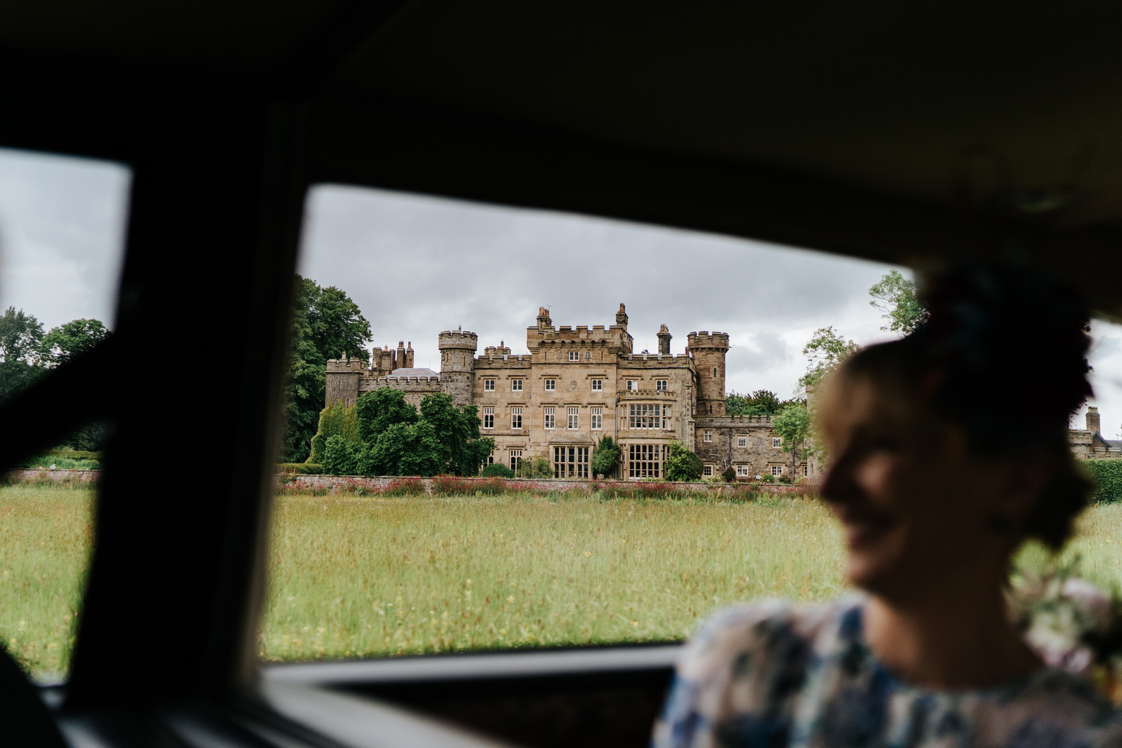 Wide photograph of Hawarden Castle Wedding Venue from the car that is driving to venue
