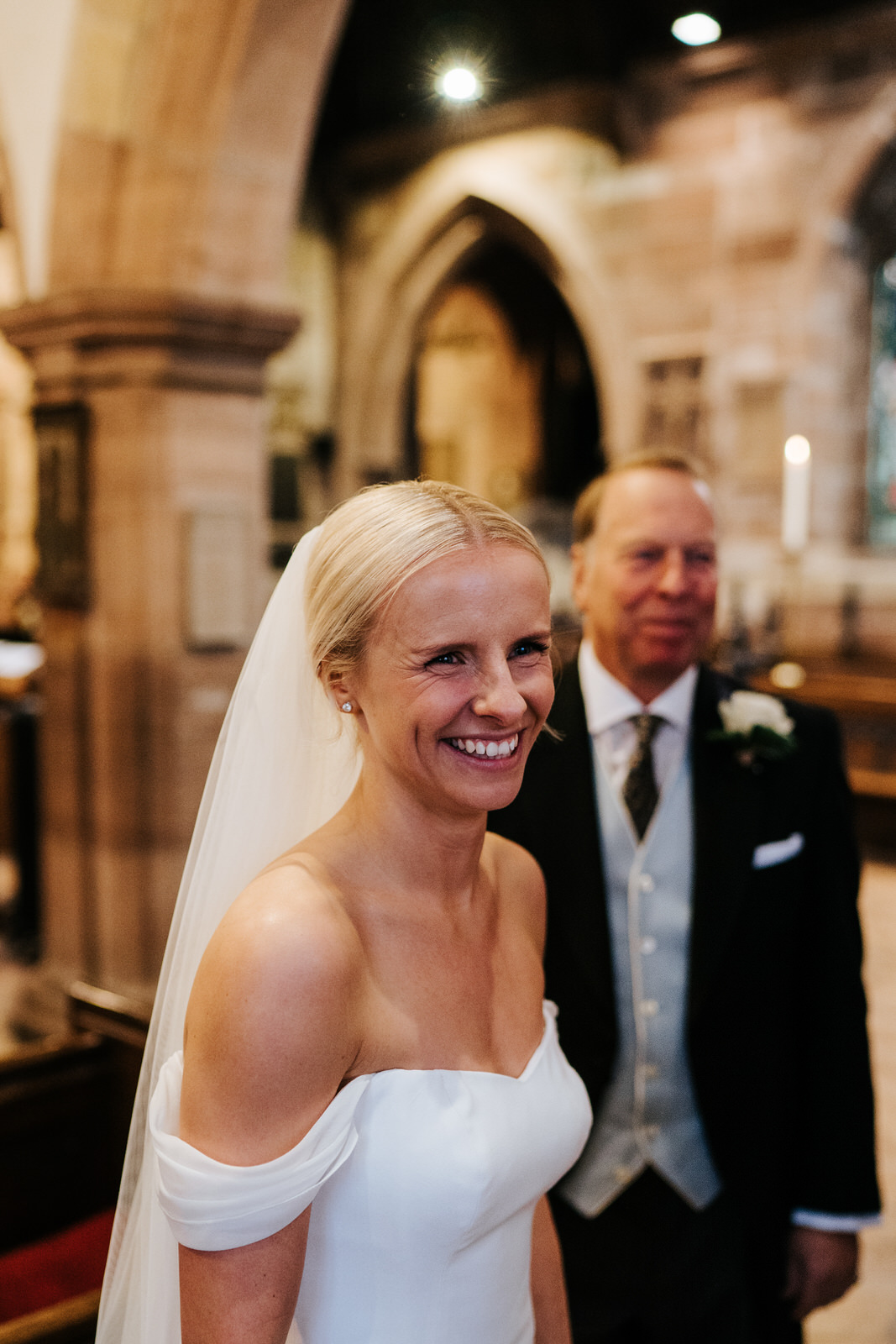 Bride smiles at someone off-camera