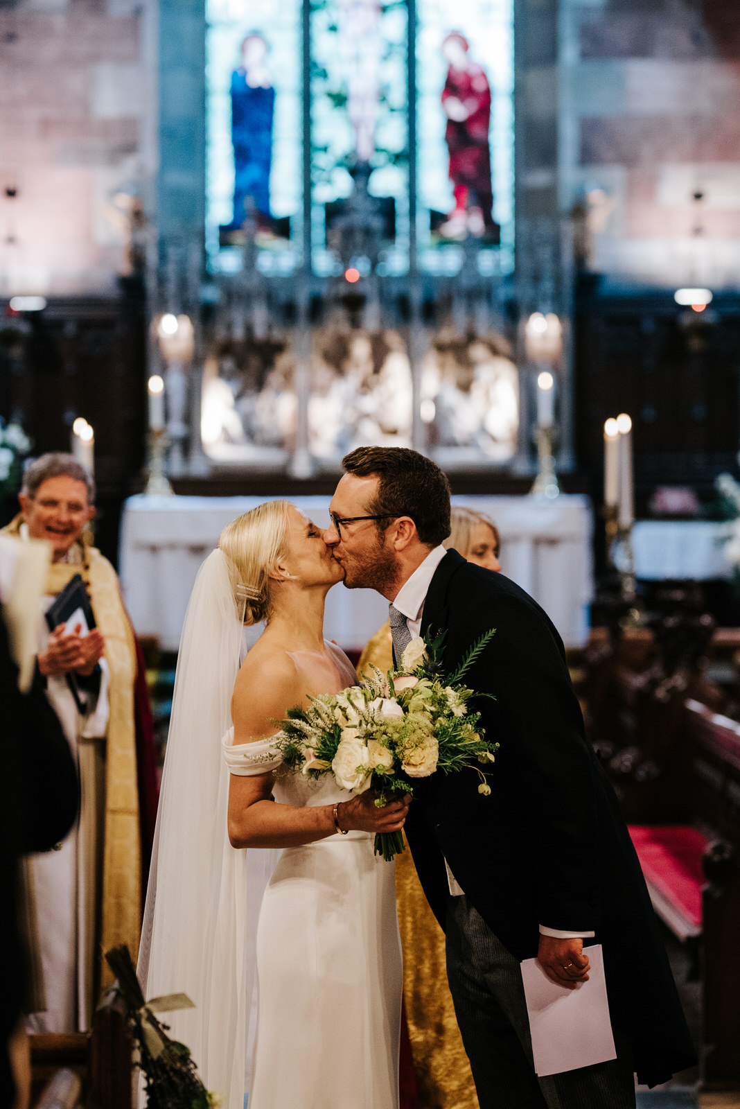 Bride and groom share first kiss before wedding ceremony ends