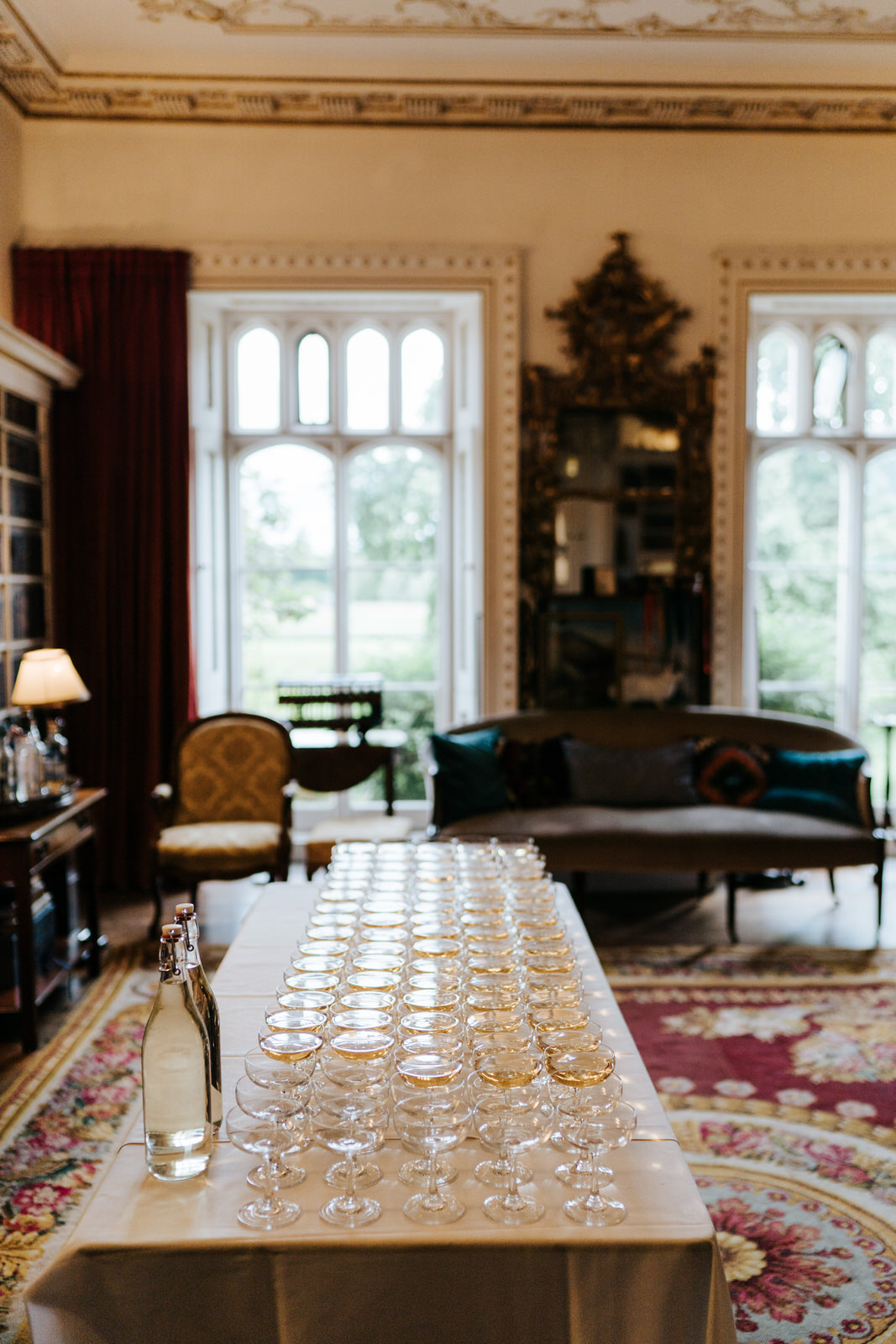 Wide photograph of the inside of Hawarden Castle focusing on a table filled with glasses and champagne