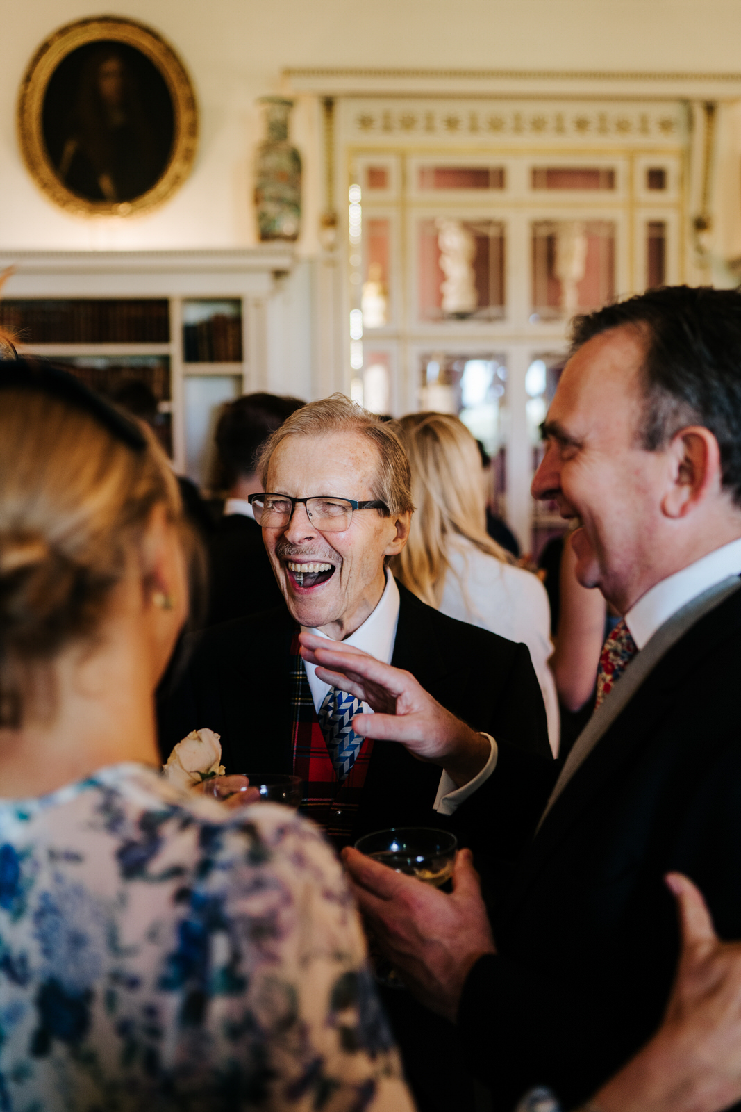Grandfather smiles during reception at Hawarden Castle