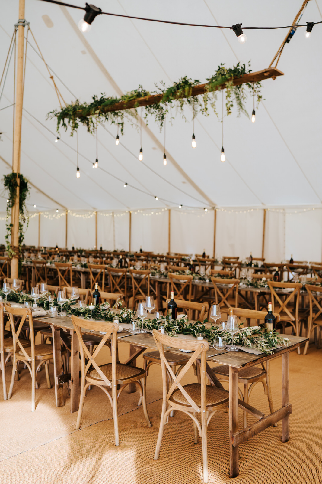 Rustic and charming table setup and decoration inside marquee in the garden of Hawarden Castle