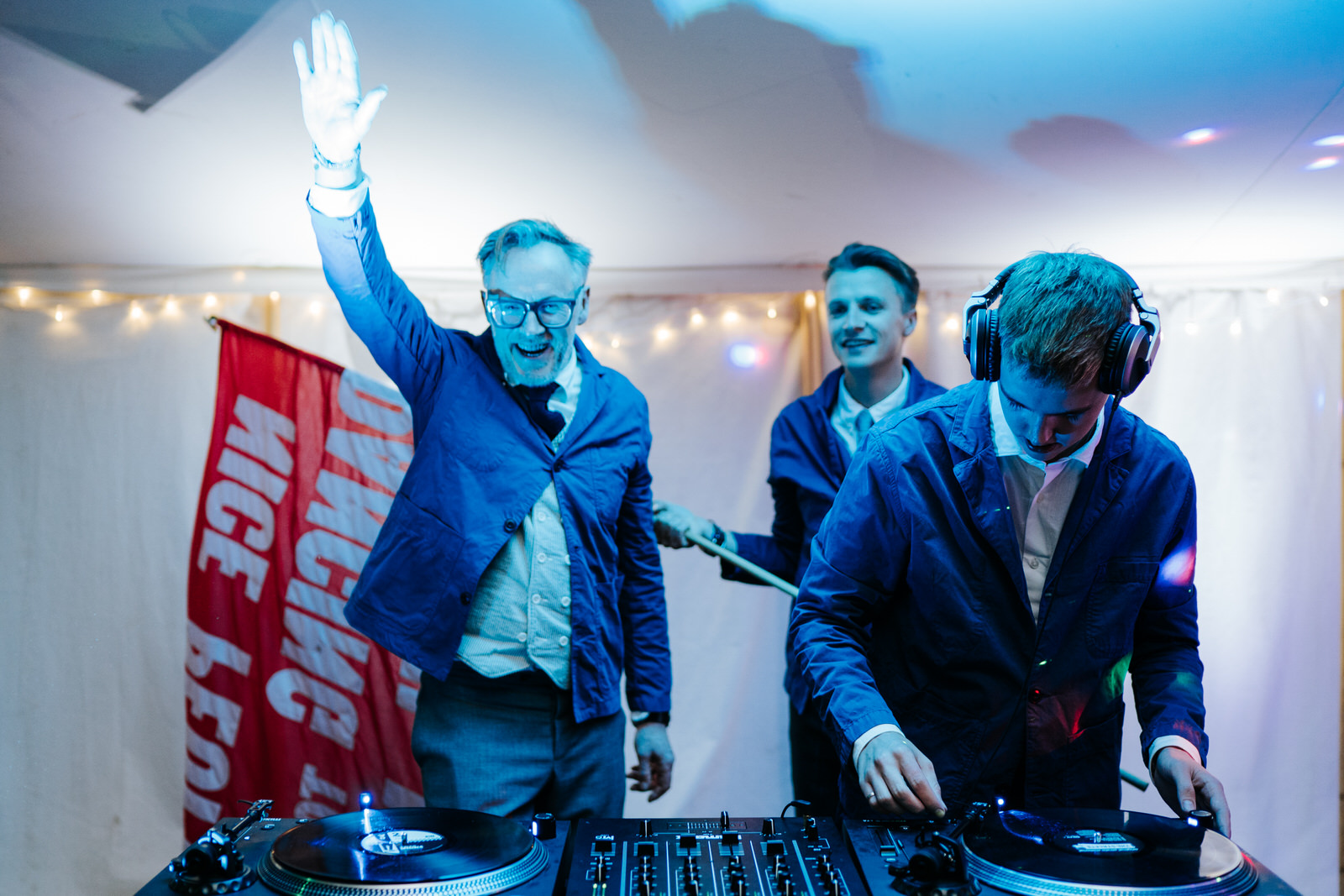 "Bride's two brothers and father behind the DJing decks performing as the ""Wedding DJs"""