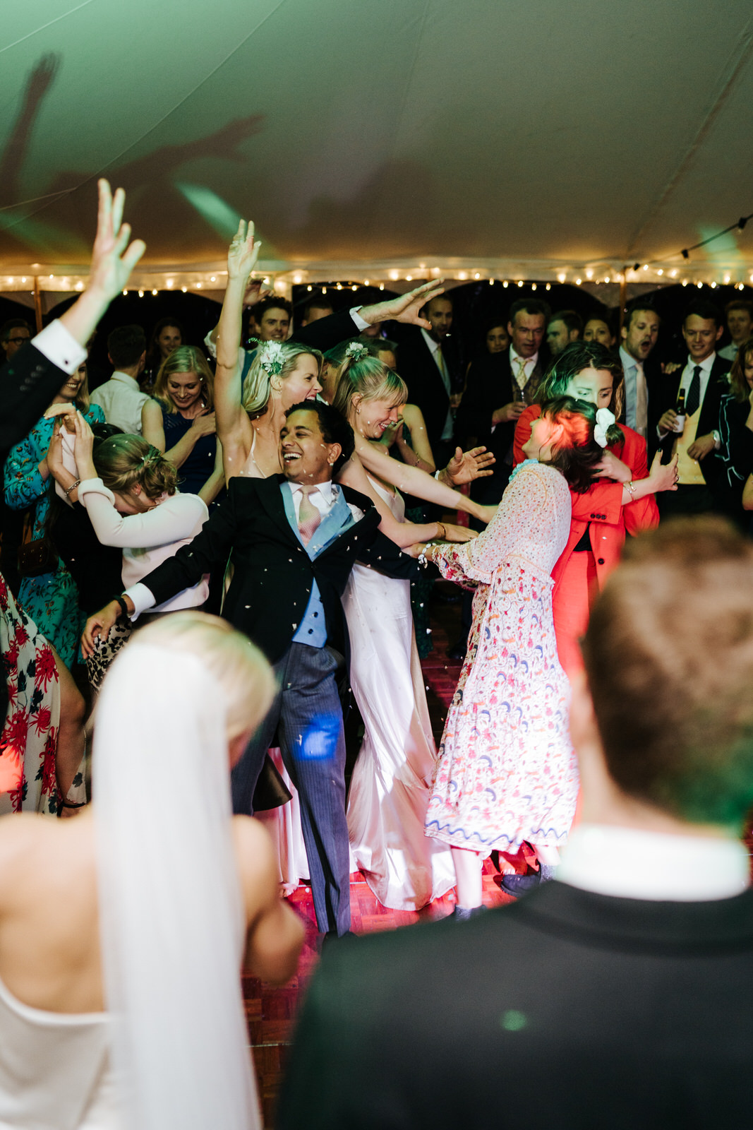 Chaos on the dancefloor as a lot of guests try to catch the bouquet at once