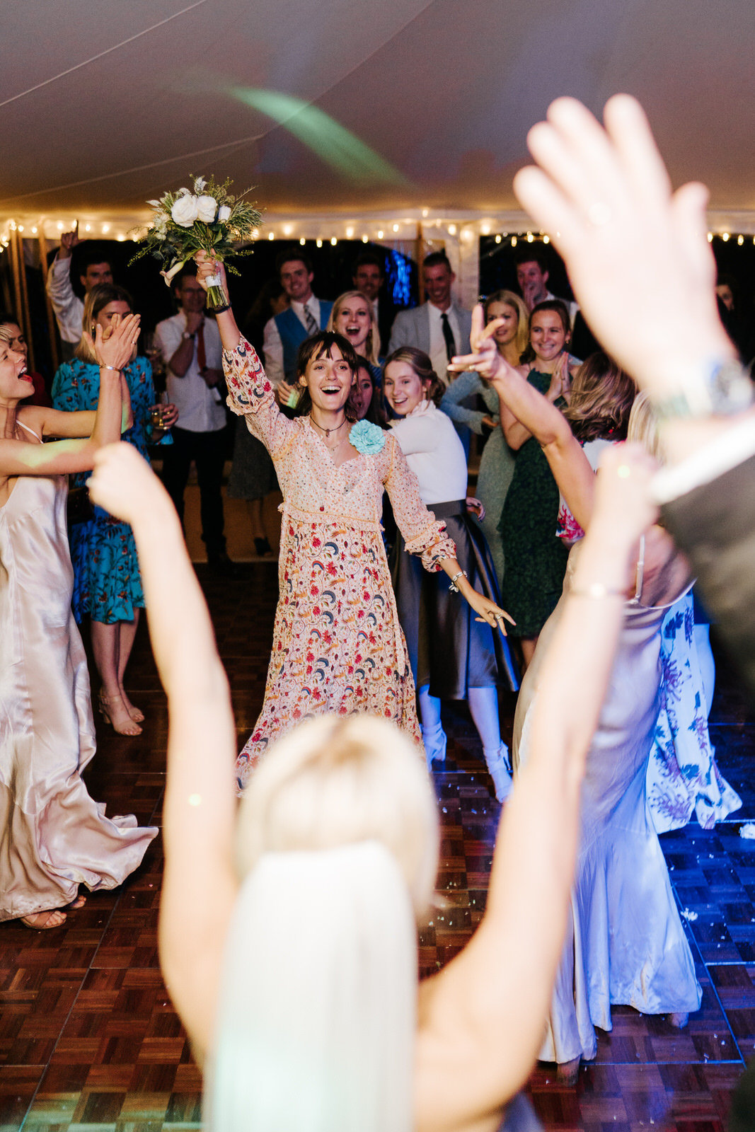 Guest emerges victorious and catches bouquet that bride threw