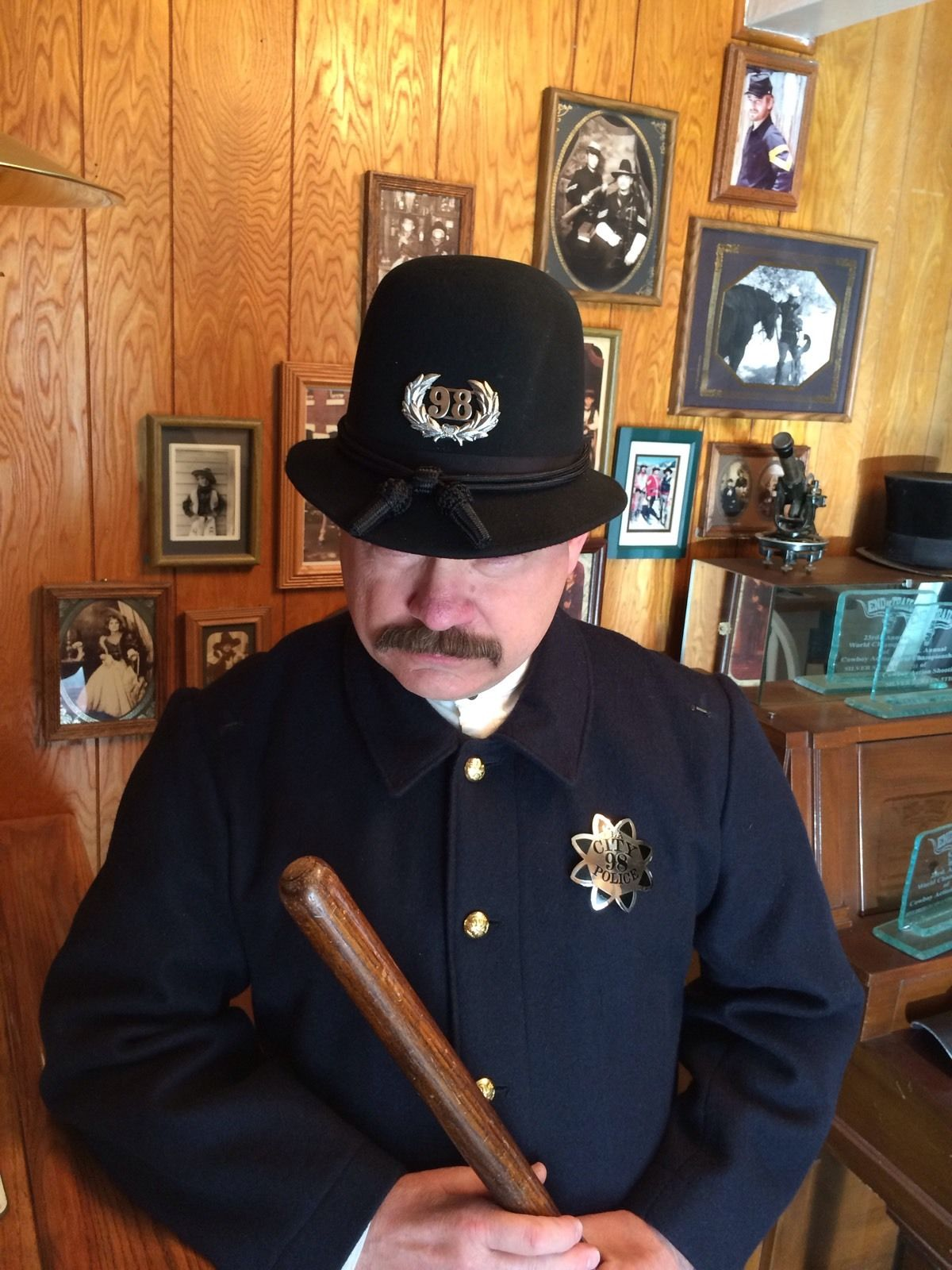 BUCK MODELING THE 1890 LAPD HELMET