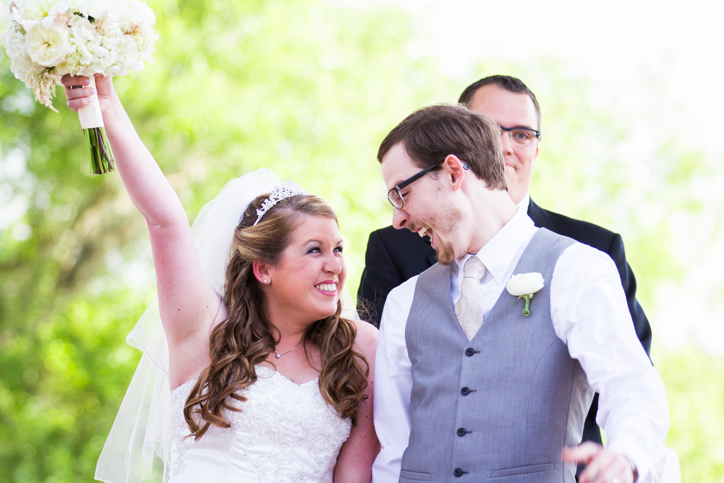Excited couple at their romantic outdoor garden wedding