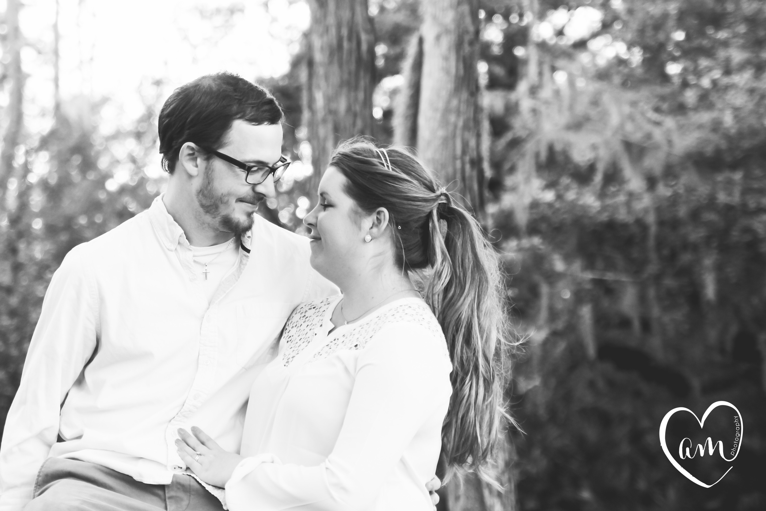 Sweet couple getting their natural engagement photos in orlando florida