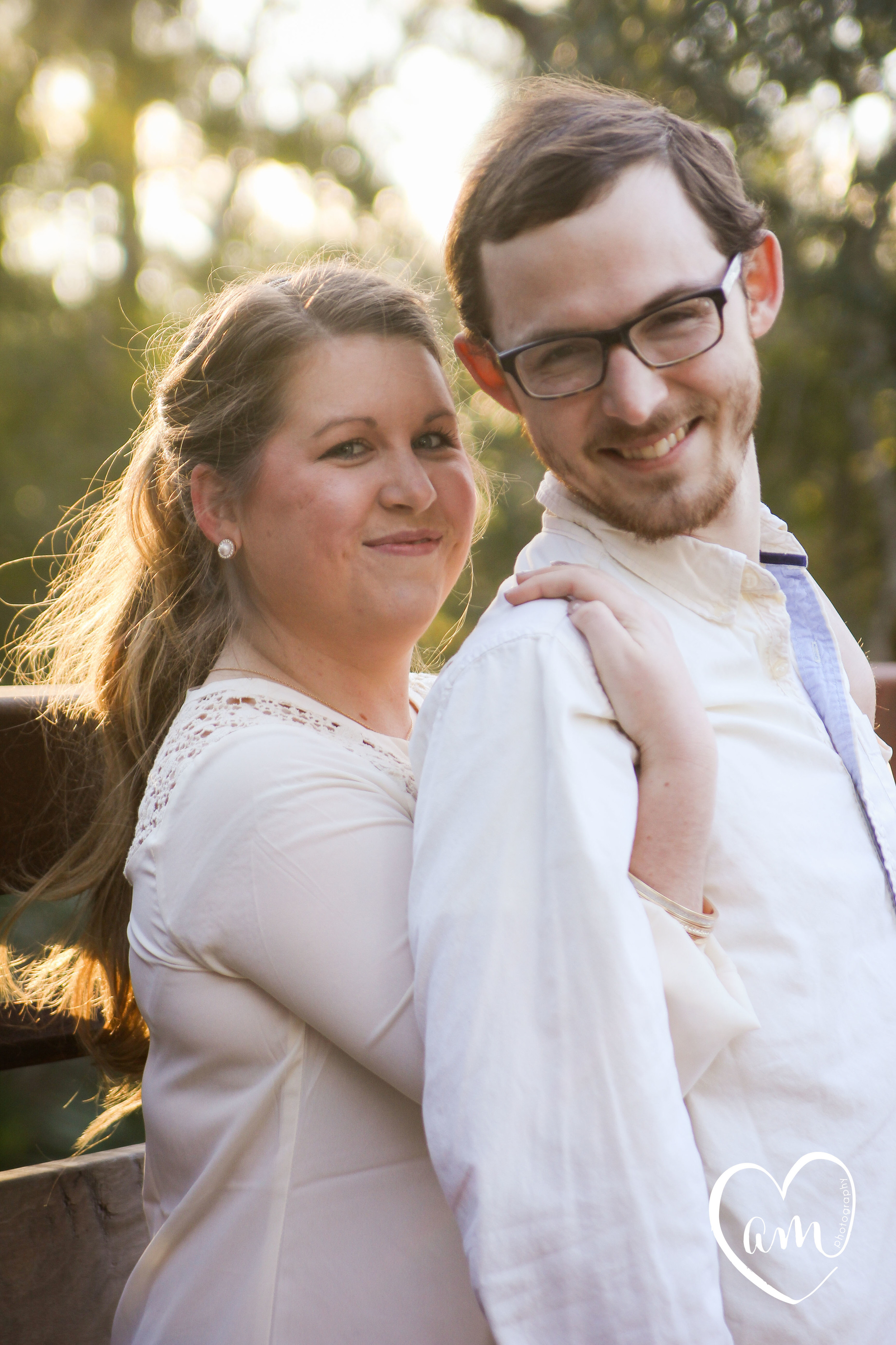 happy couple have a sweet moment during their engagement photography session in Kissimmee