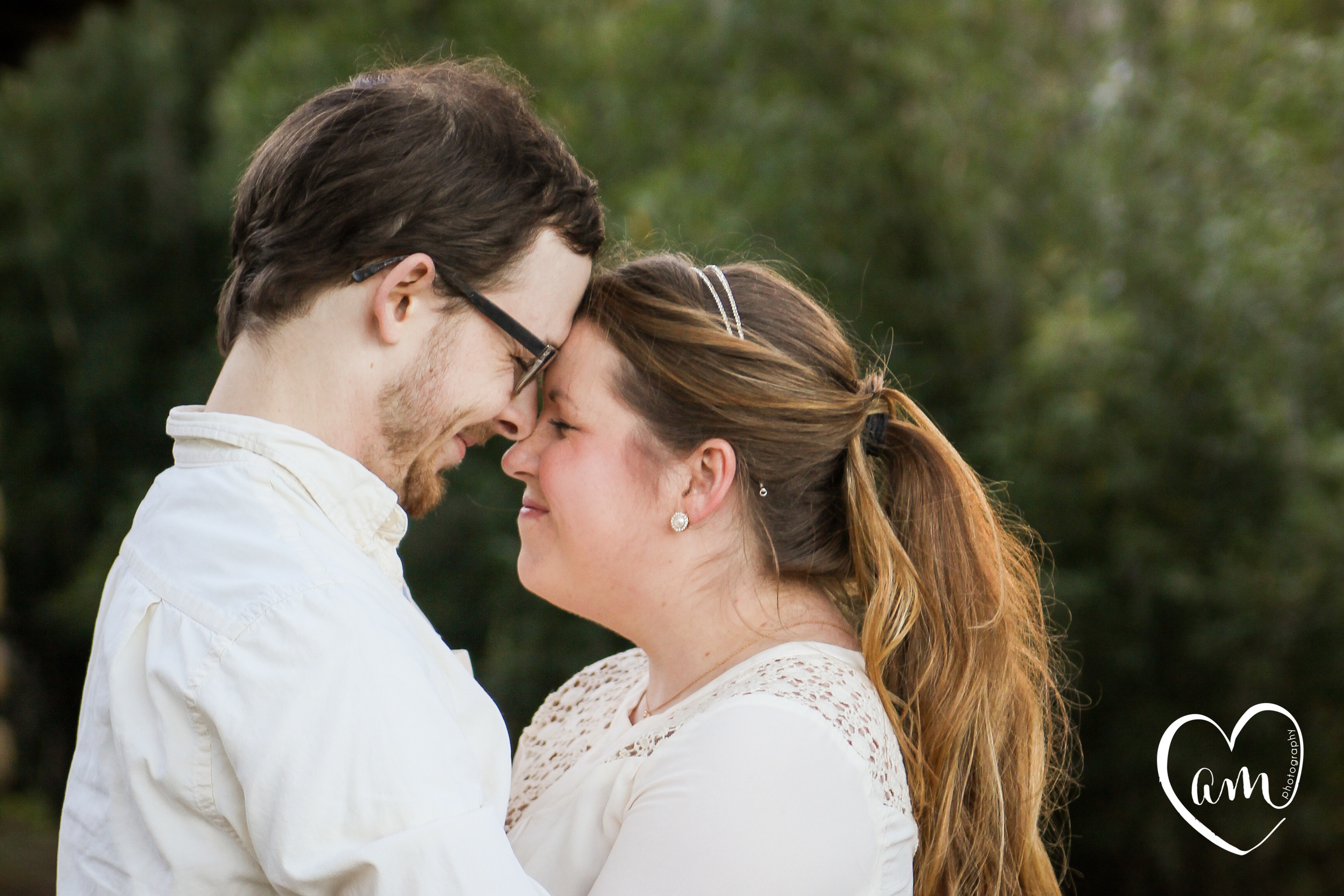 Happy and fun couple take whimsical engagement photos in Orlando