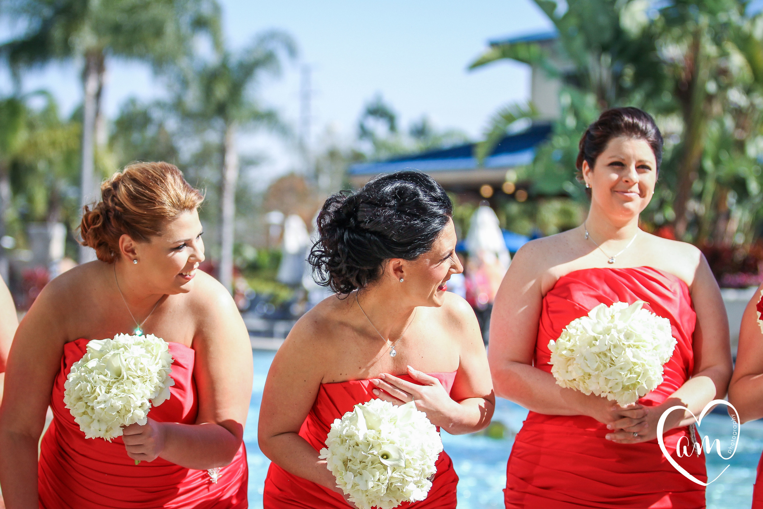 Bridesmaids laugh during formal bridal party photos at Hilton on I Drive wedding