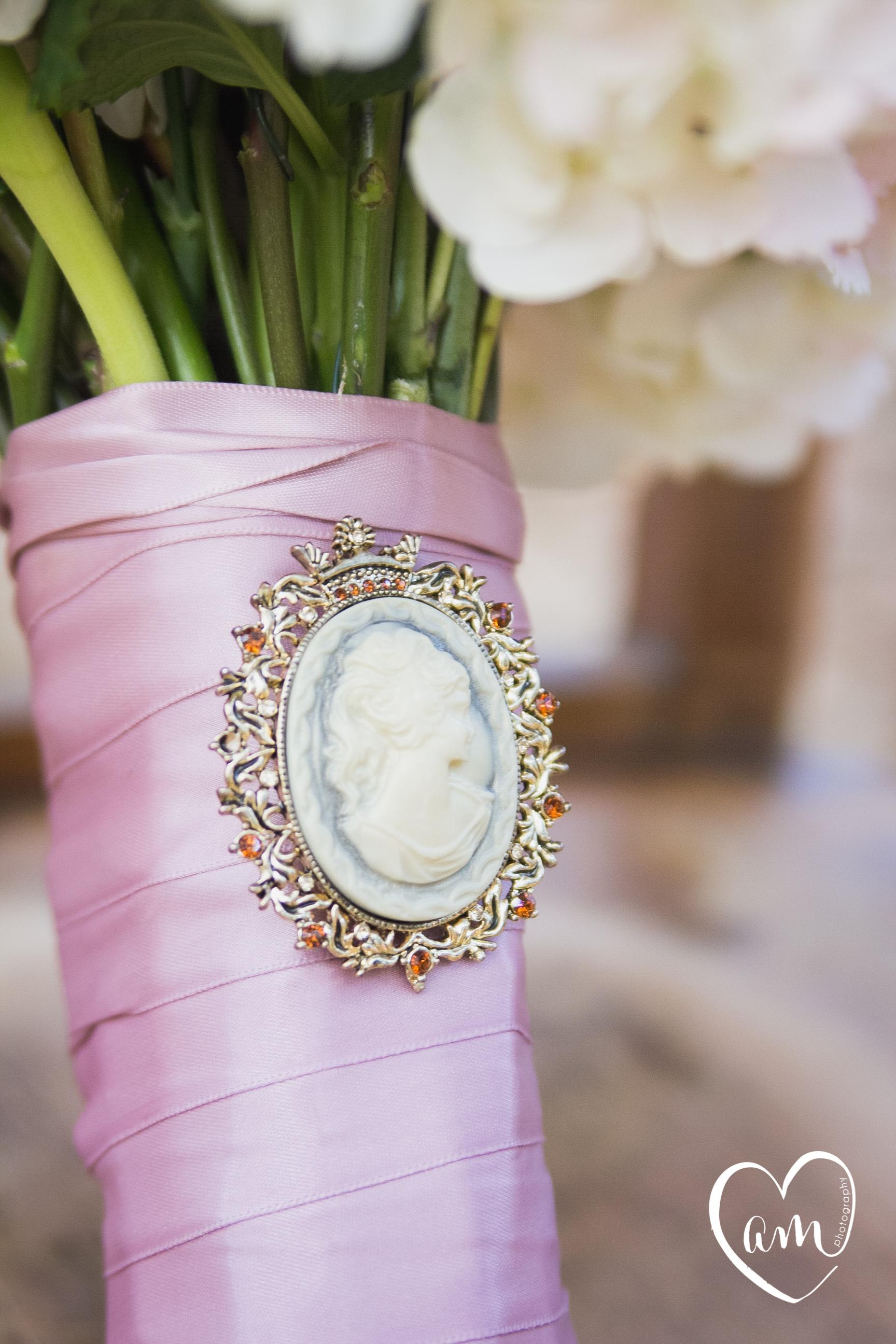 Broach on Bridal Bouquet photographed by Florida Destination Wedding Photographer