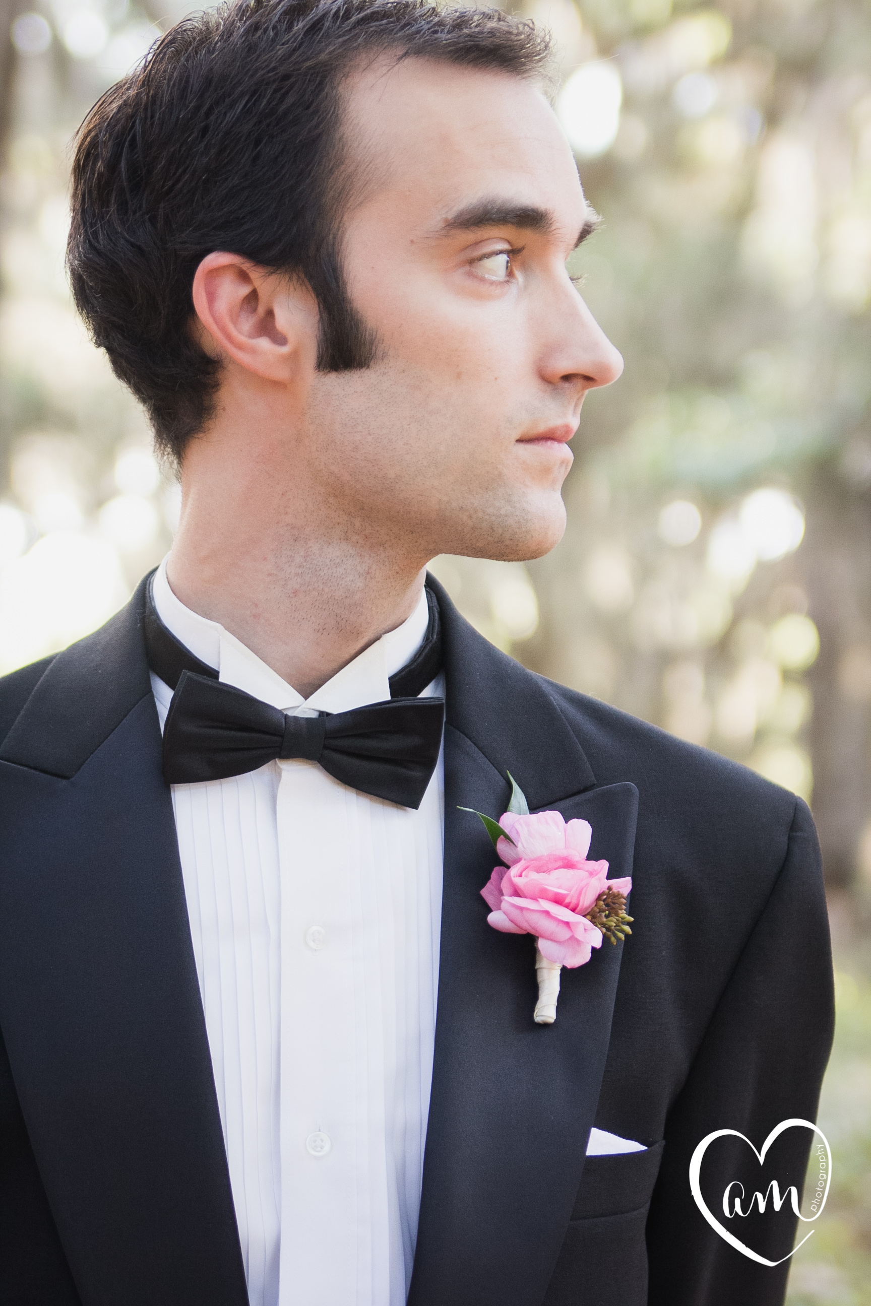 Pink boutonniere photographed by Florida Destination Wedding Photographer