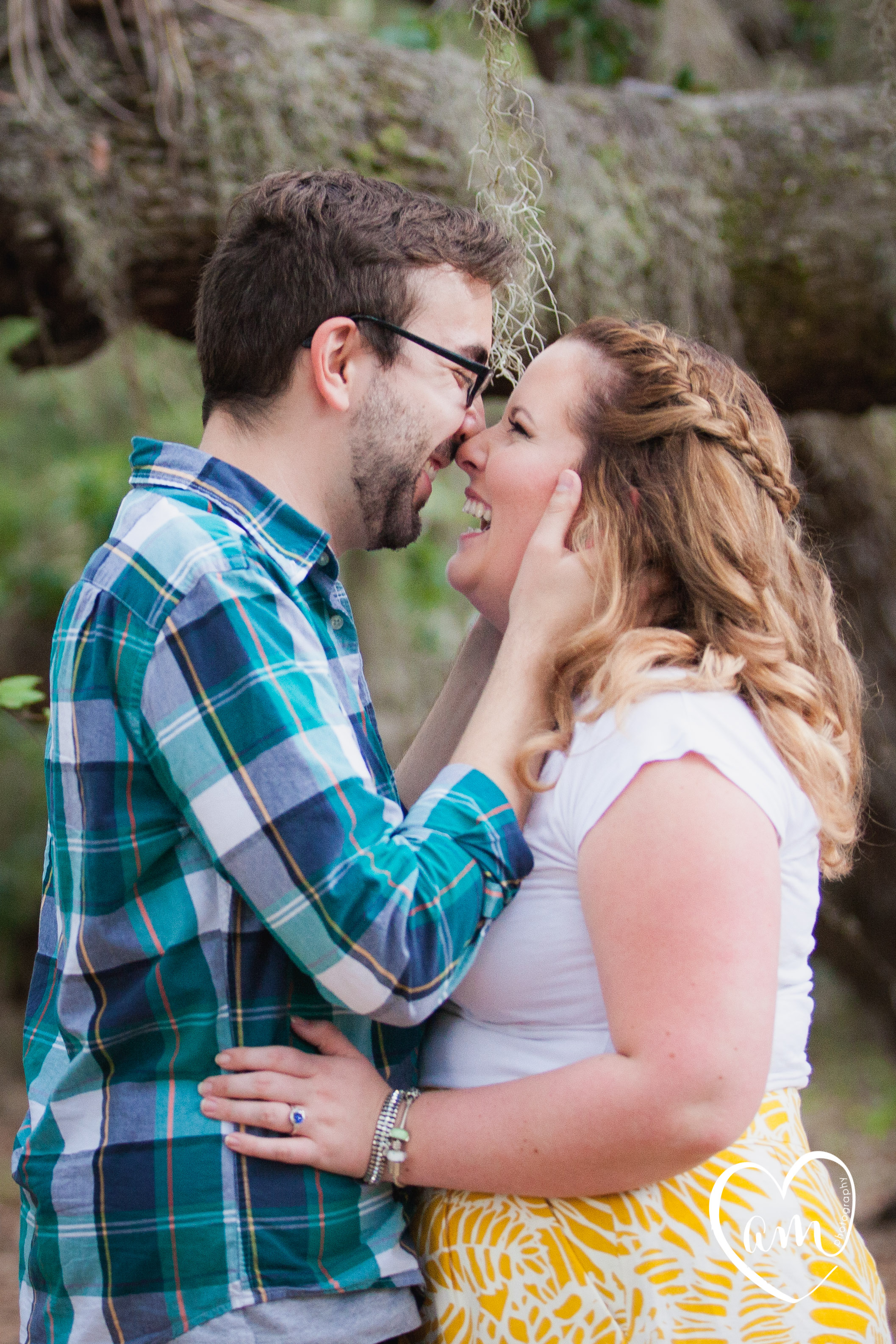 Engagement Photos taken in a Florida forest by destination wedding photographer