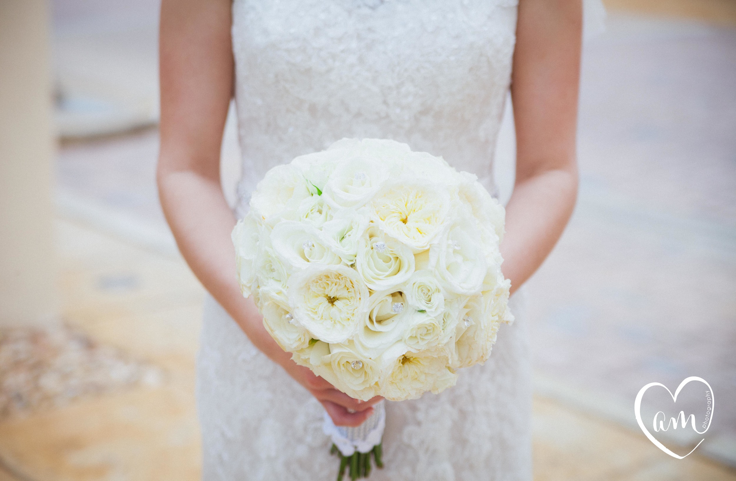 White bridal bouquet. Photo by Amanda Mejias Photography: Destination Wedding Photographer.