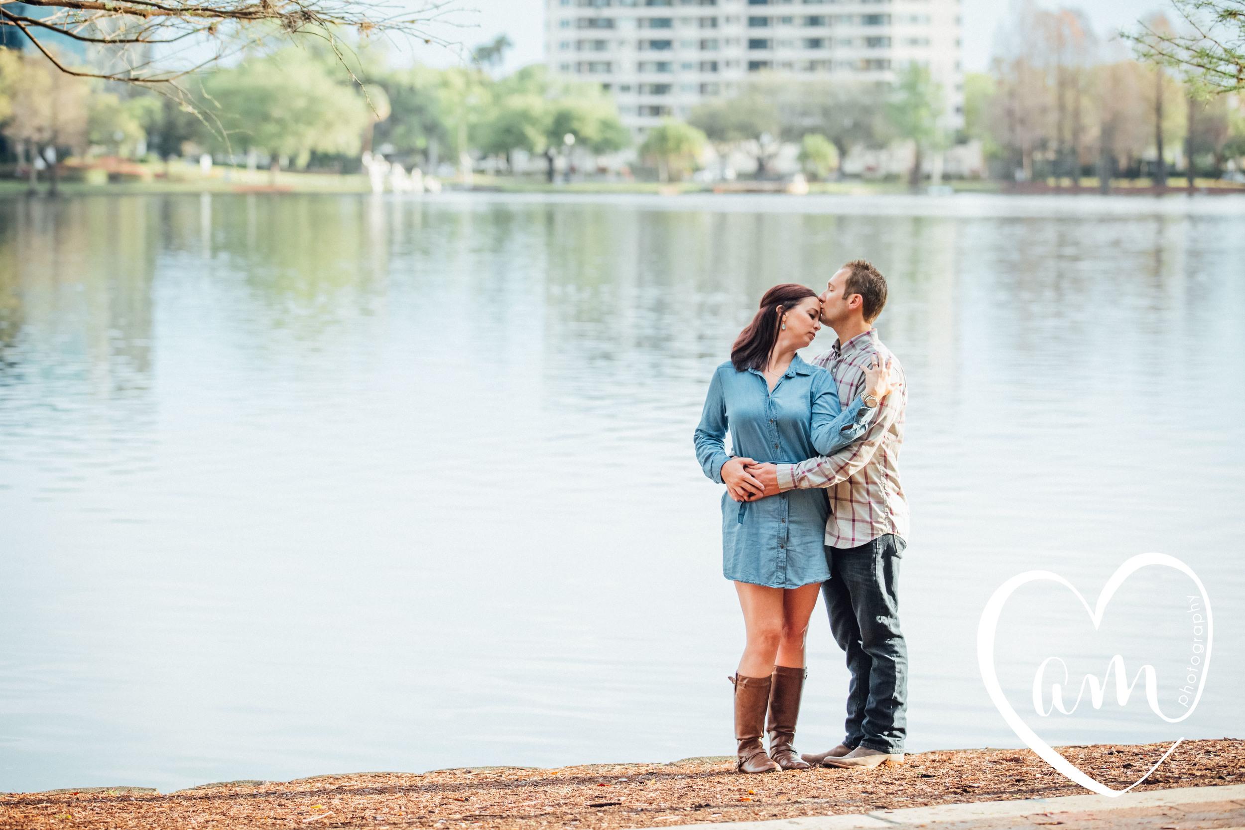 Engagement photos at Lake Eola. Church Street engagement session. Photo by Amanda Mejias Photography: Orlando wedding photographer.