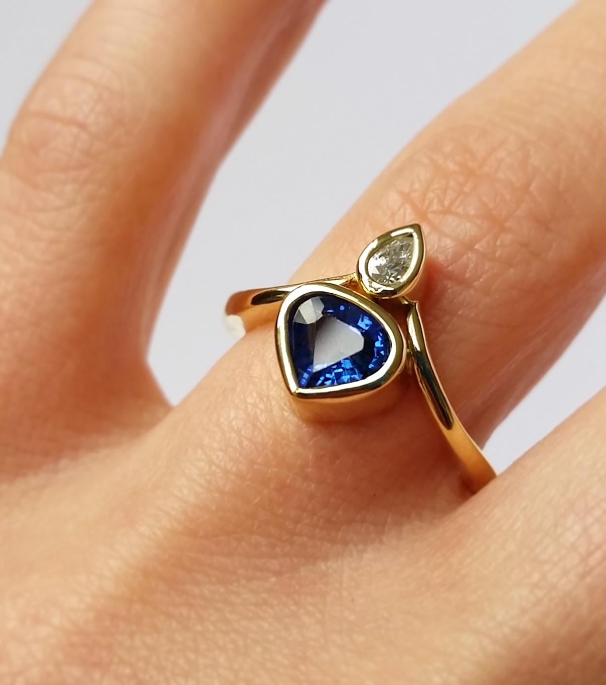 Blue Sapphire and White Diamond Ring