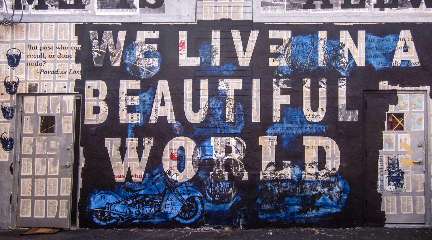 """Wynwood street art in Miami photographed by Trinity Photography """"We live in a Beautiful World."""""""