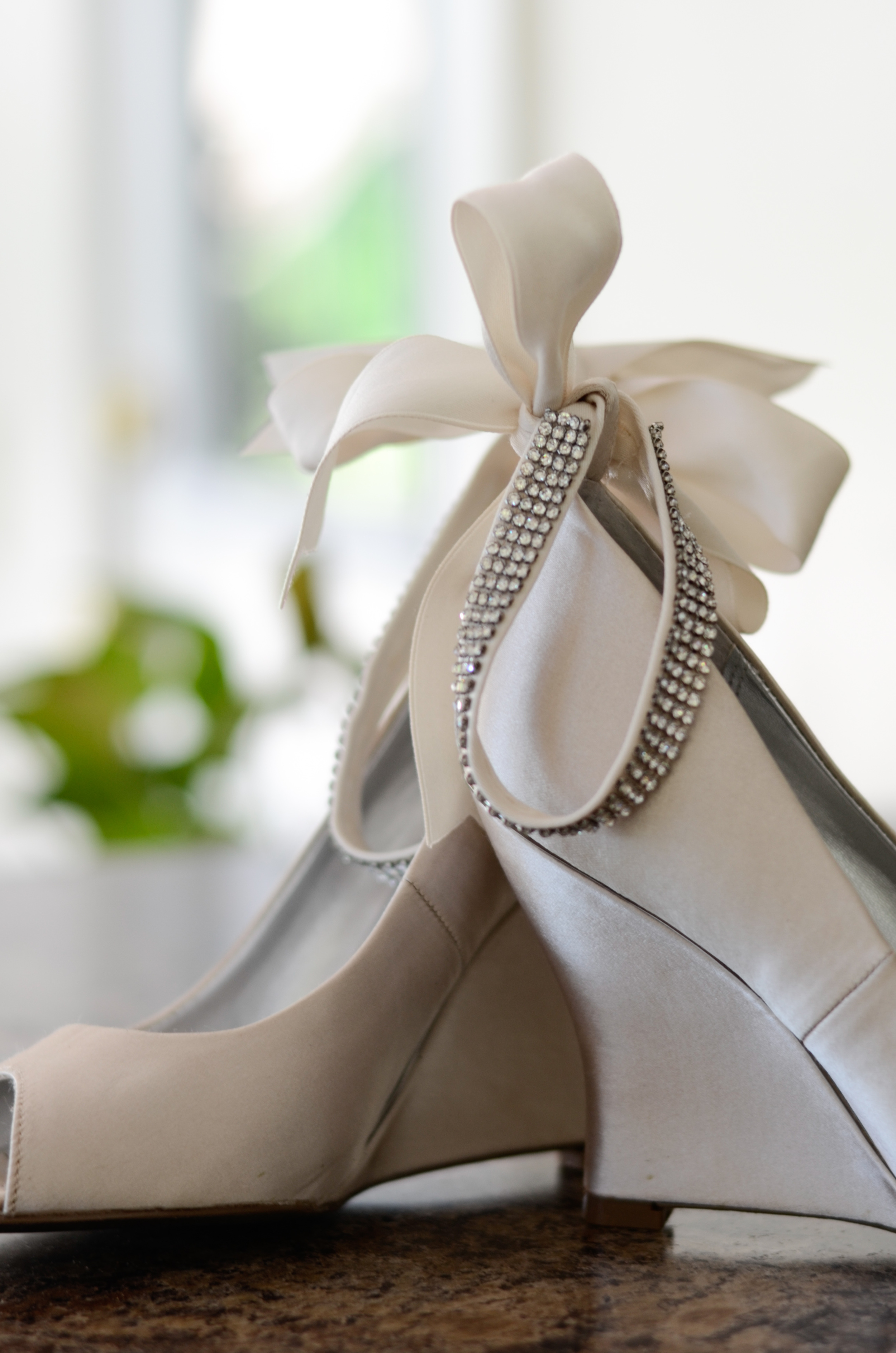 Satin bowedand rhinestone ivory wedge heels were the shoe of choice for Anna.