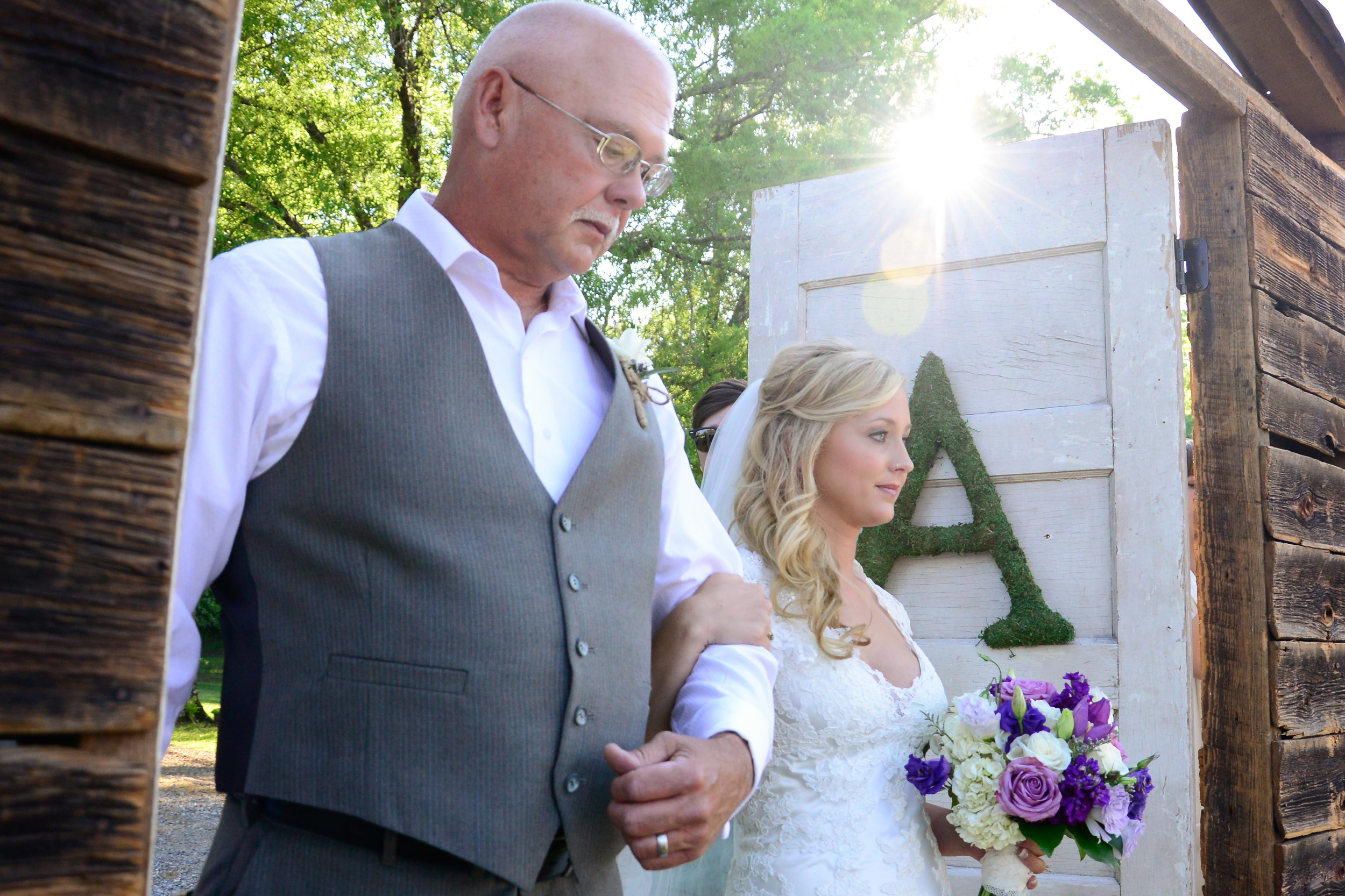 To bring the drama of a chapel weddinginto an outside ceremony, trysetting up doors to be swept open when the bridal march begins and the bride enters.