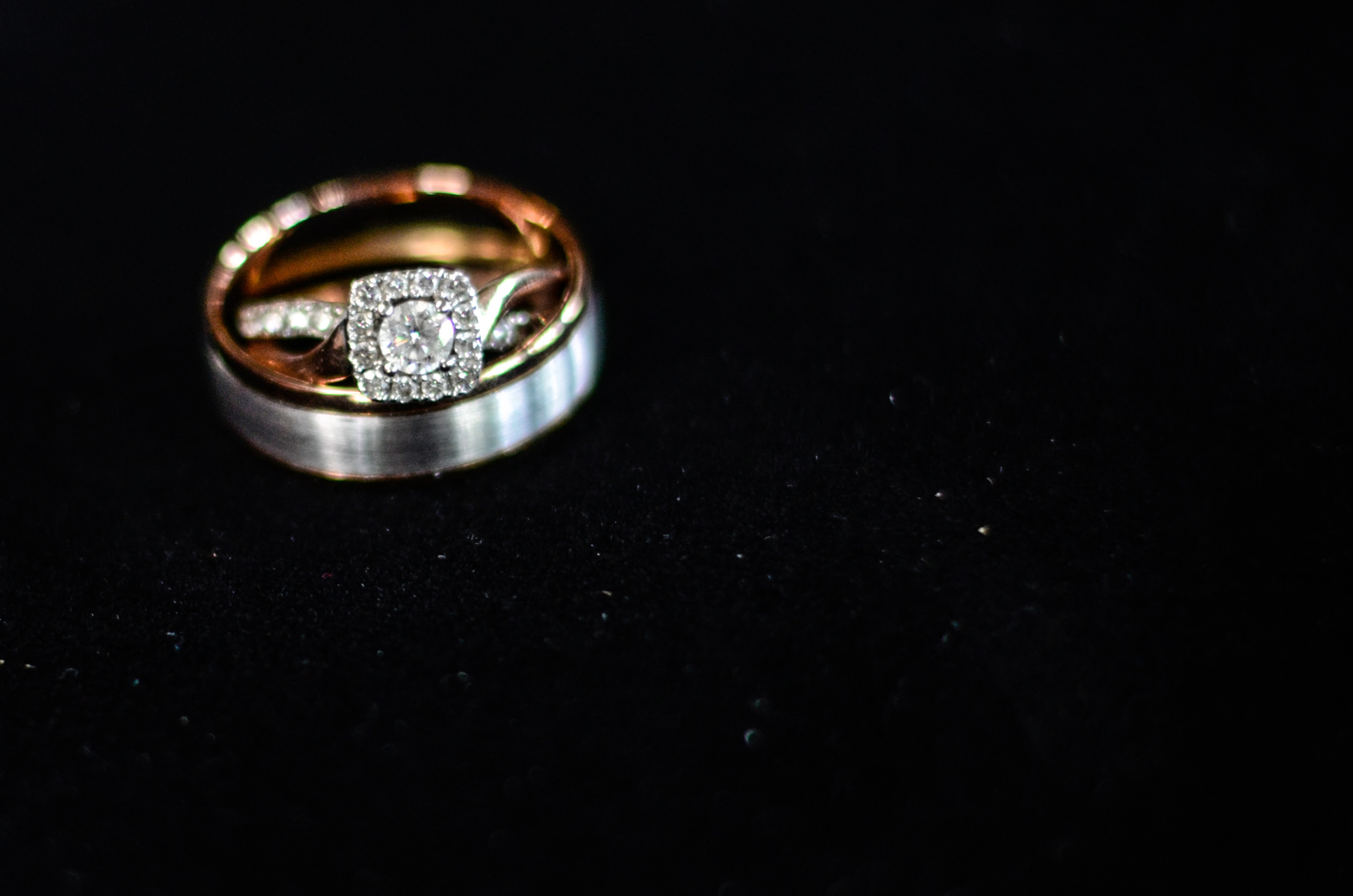 Silver and Rose Gold engagement ring and Groom's wedding band.