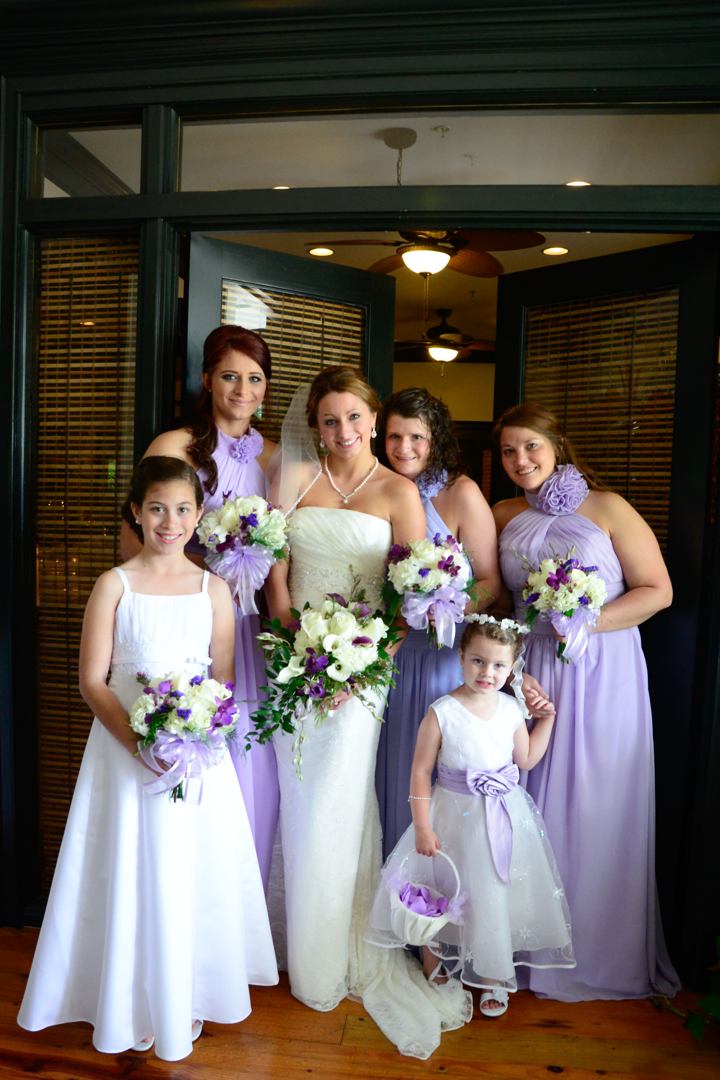 The Bridesmaids were in lilac full length dresses with tropical inspired bouquets by The Floral Case.