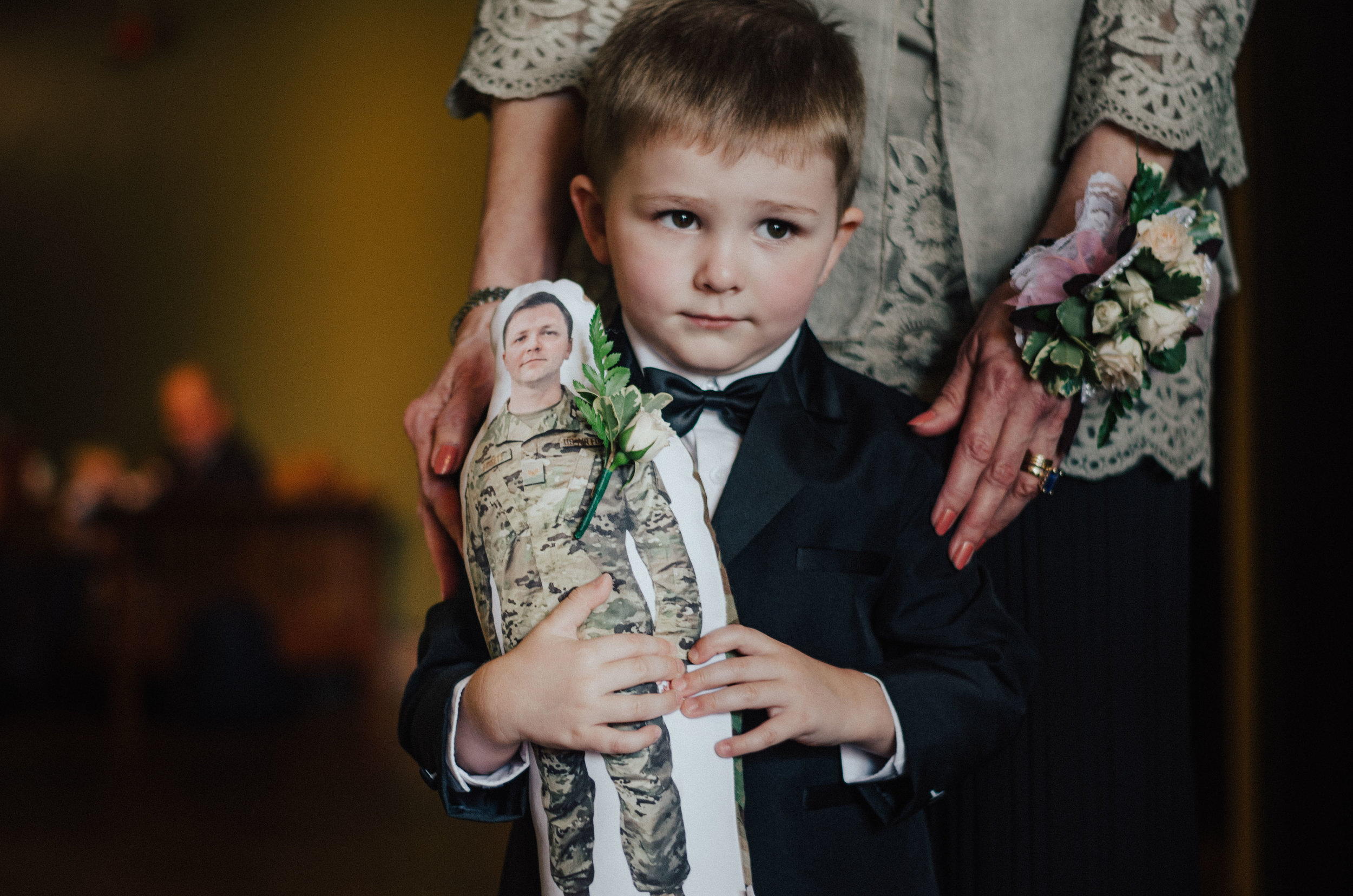Justin's brother was deployed during their wedding, so they had this little doll made for his nephew which the little guy carried with him all day. Cue all the tears!
