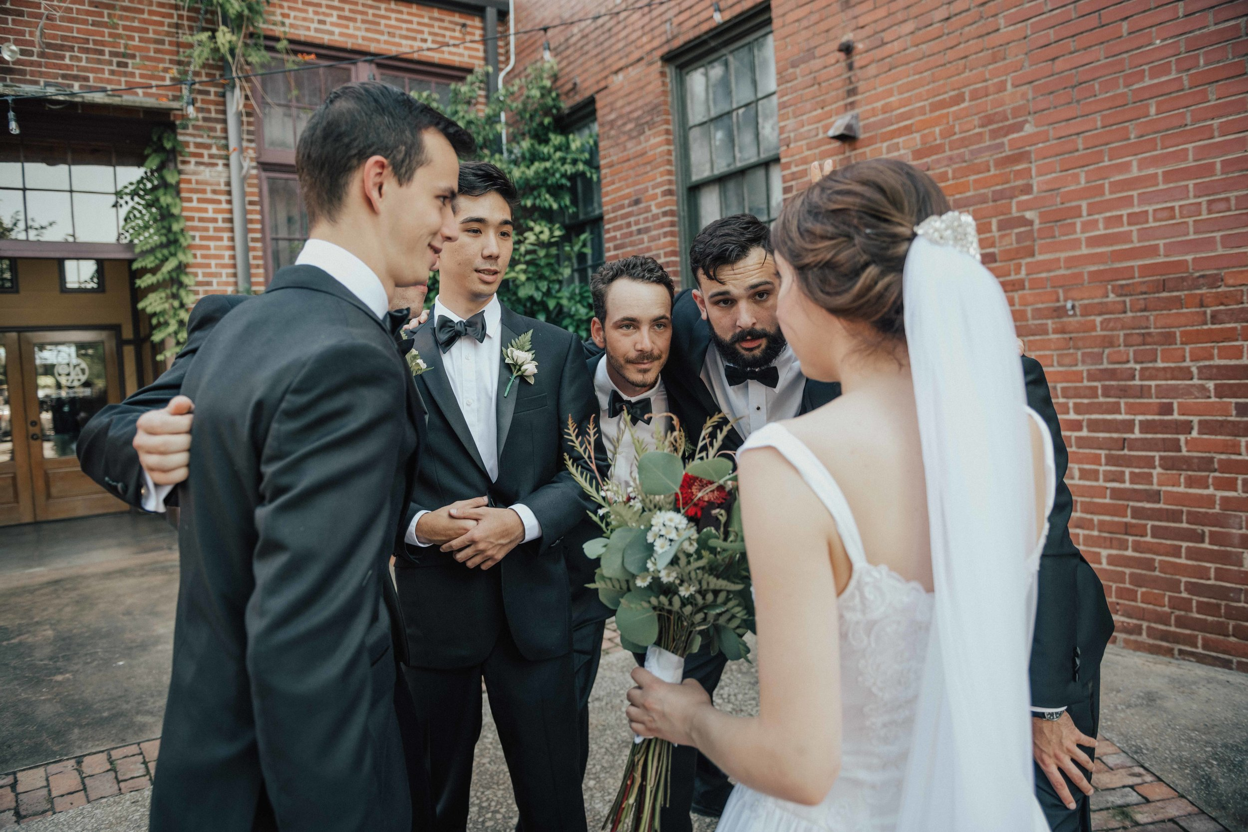 Love when the bride pulls all the groomsmen together to give them the game plan for the day!