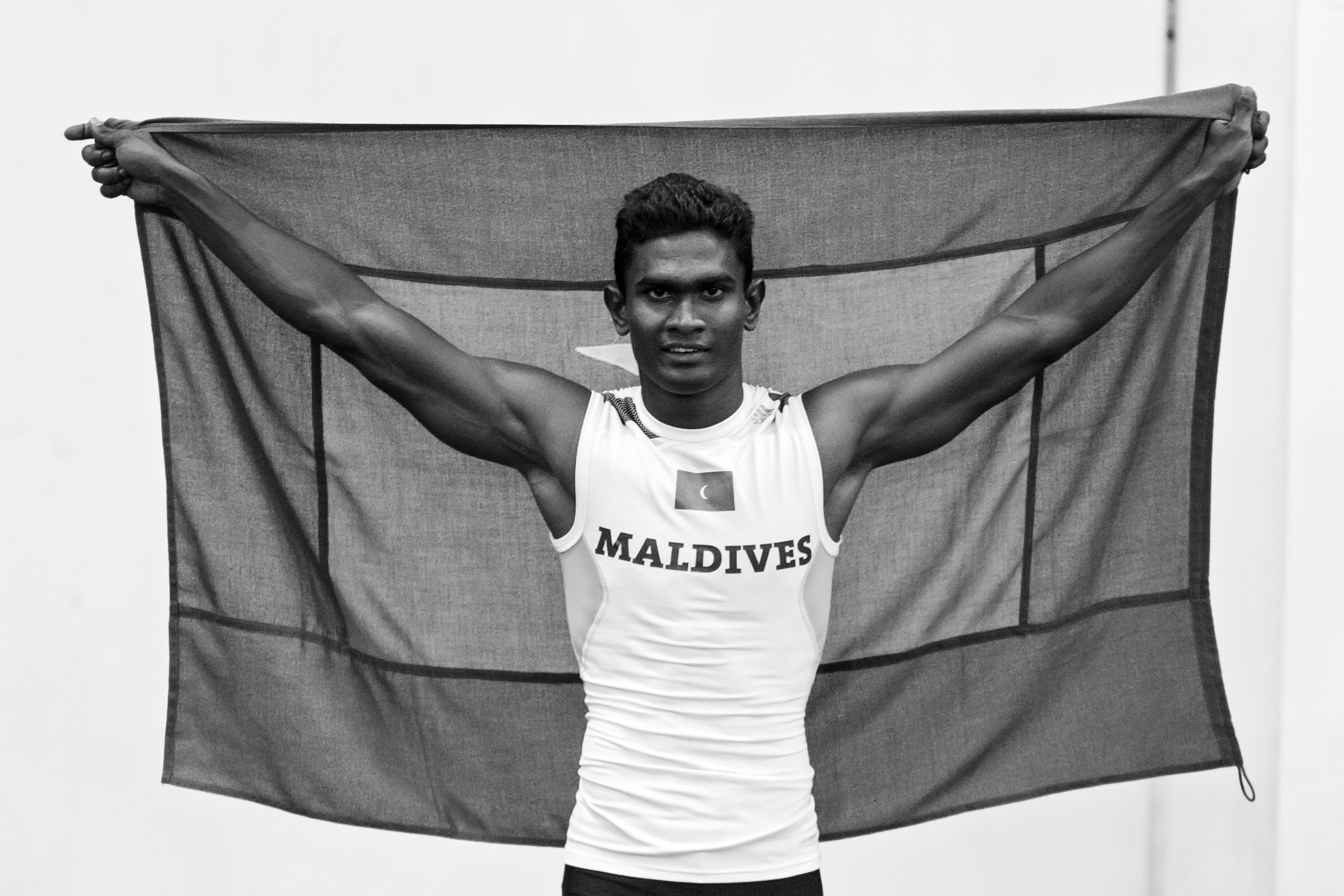 Raising the Maldivian flag after winning the Gold Medal