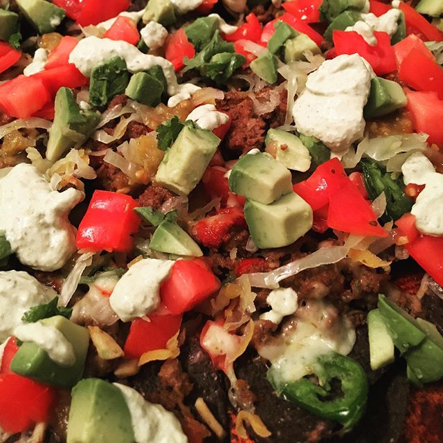 Is probiotic nachos a thing? If not, you heard it here first! #toppingpalooza #probioticnachos #curtido #lactofermentation #grilledpoblanos #roastedpeppers #plentyofpepperjack #homegrowntomatoes #kalonasourcream