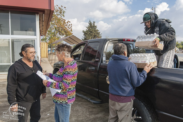 Donna Johnson delivers bottled water to local residents of East Porterville whose wells have run dry