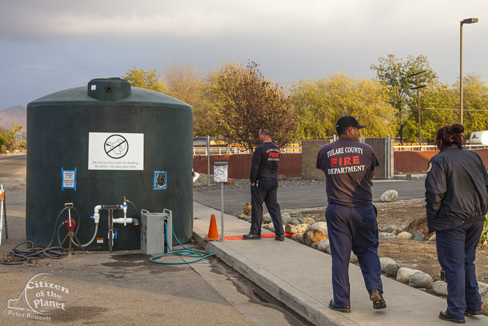 The local fire department in East Porterville provides water to residents