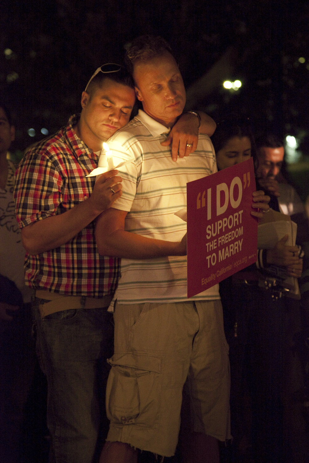 "Gay marriage ban declared unconstitutional in California. Several hundred people gathered for a candlelight vigil on Olivera Street near downtown Los Angeles, on the evening of August 4, 2010, to celebrate a California federal judge's ruling that Proposition 8, the state's ban on same-sex marriage that was passed by voters last November, was unconstitutional. The ""Day of Decision"" vigil was organized before the ruling was announced for opponents of Proposition 8 to either support or protest the impending decision. Both sides had pledged to appeal the ruling depending which way it went. Olivera Street, Los Angeles, California, USA"