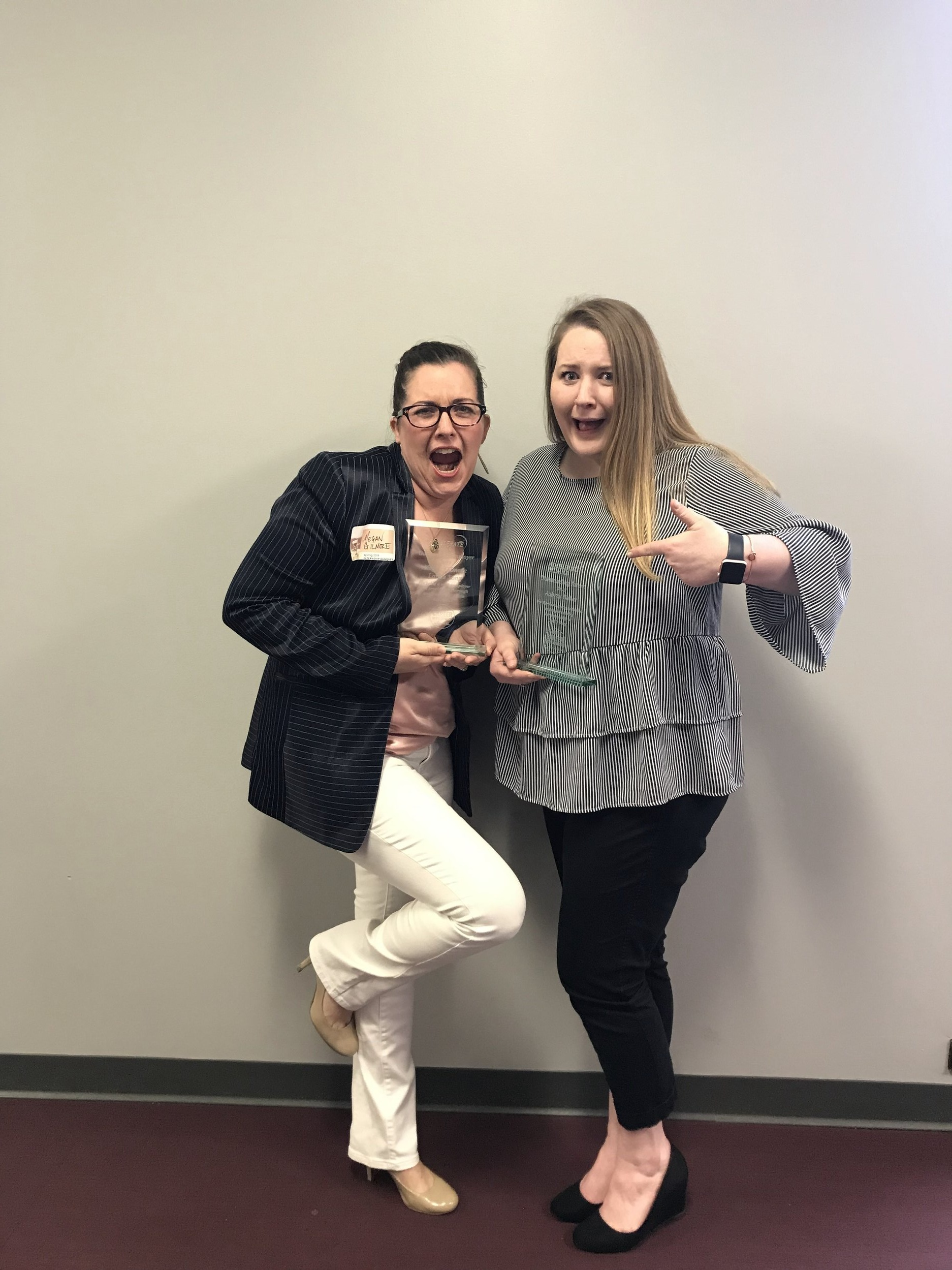 We're outstanding! Megan Gilmore with Aubrey Baker winning their Outstanding Employer and Outstanding Intern of the Year Awards in April 2019.