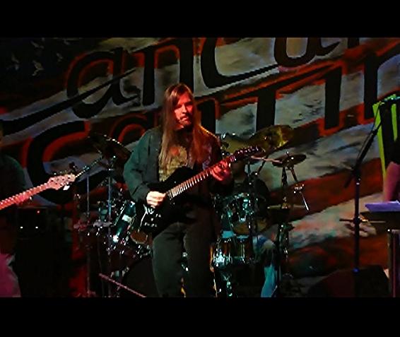 John playing on stage