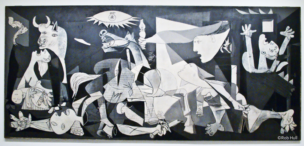 This is a photo of Guernica, the mural-sized oil painting by Pablo Picasso. This painting is in the Museum Reina Sofia in Madrid, Spain.