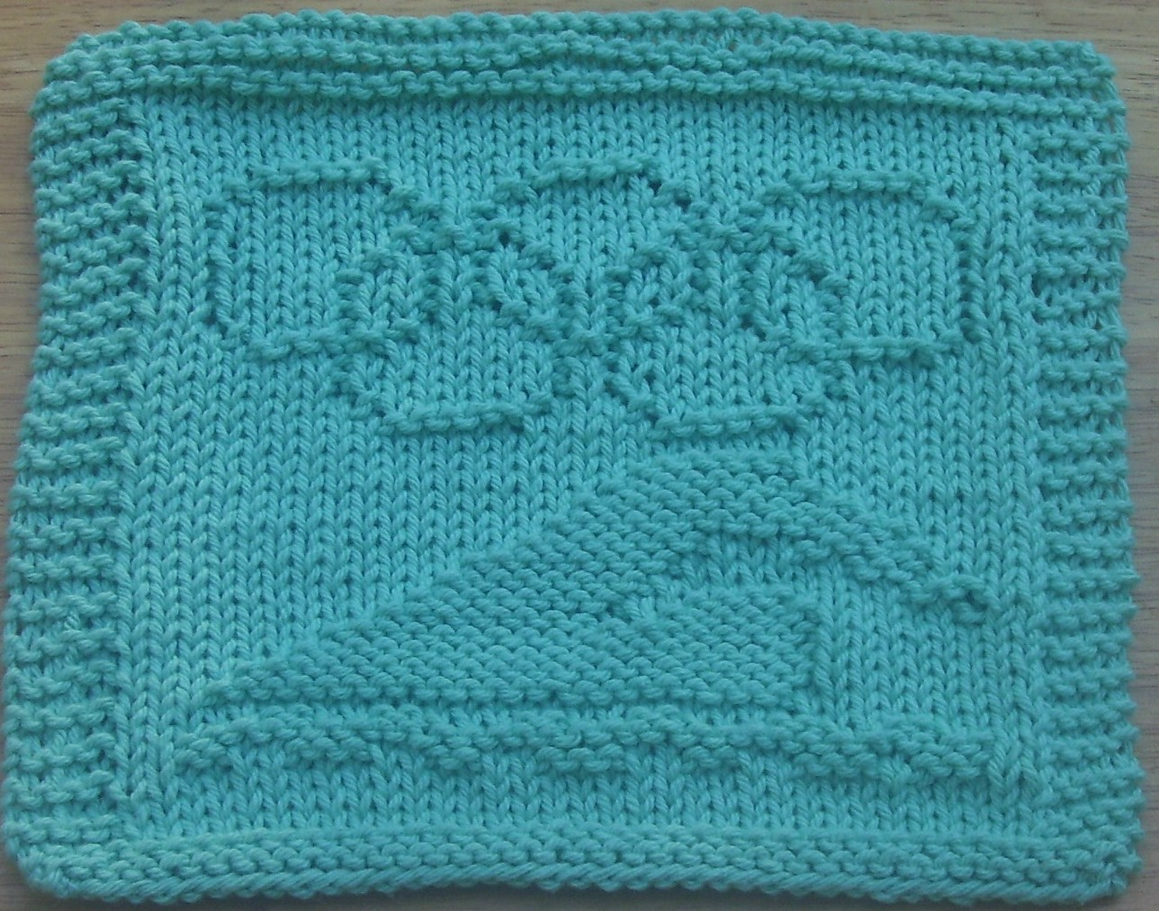 http://digknittydesigns.blogspot.com.au/2008/08/olympic-swimmer-knit-dishcloth-pattern.html