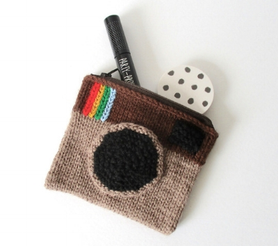 http://www.ravelry.com/projects/fluffandfuzz/camera-purse