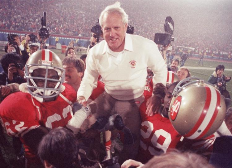 Bill Walsh hoisted up on the shoulders of his team, when the San Francisco 49ers defeated Miami, 38-16, in Super Bowl XIX in 1985