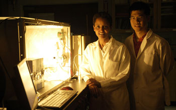 Sossina Haile and William Chueh next to the benchtop thermochemical reactor used to screen materials for implementation on the solar reactor. Image via  CalTech