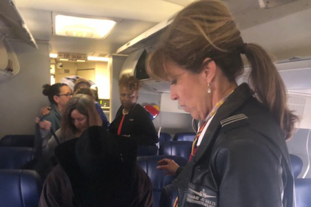 Photo of Southwest Airlines pilot Tammie Jo Shults, right, speaking to passengers after Flight 1380's emergency landing in Philadelphia by Diana Self.